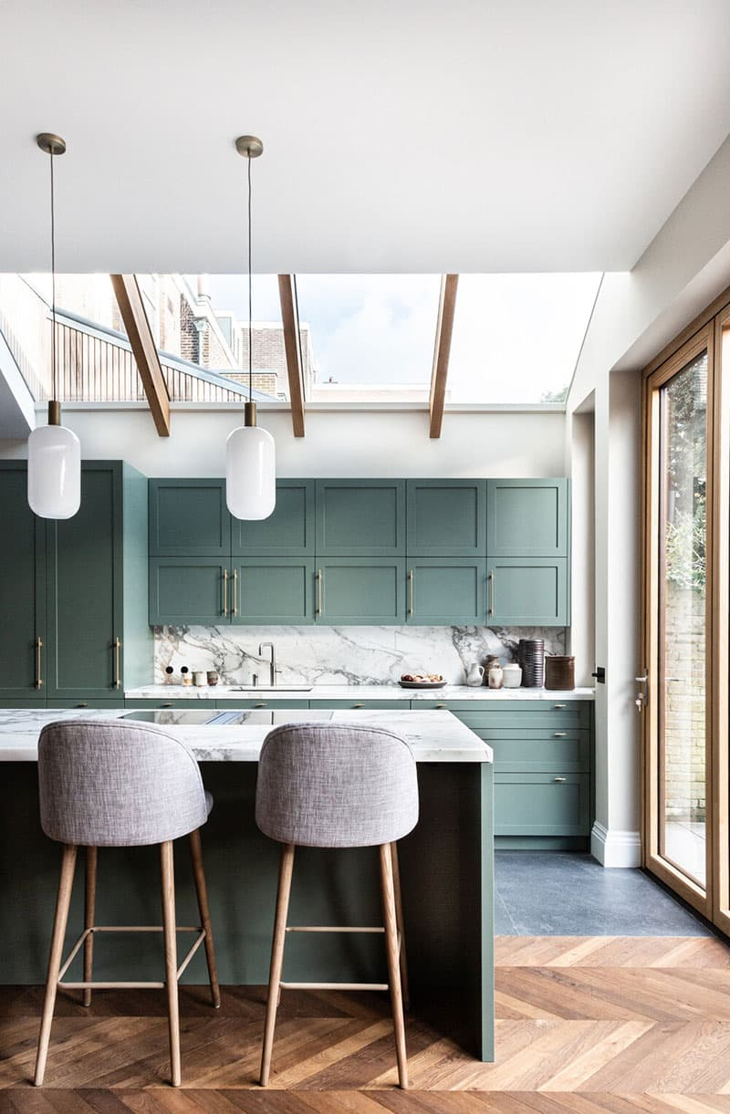 this is a mid century modern kitchen with olive green