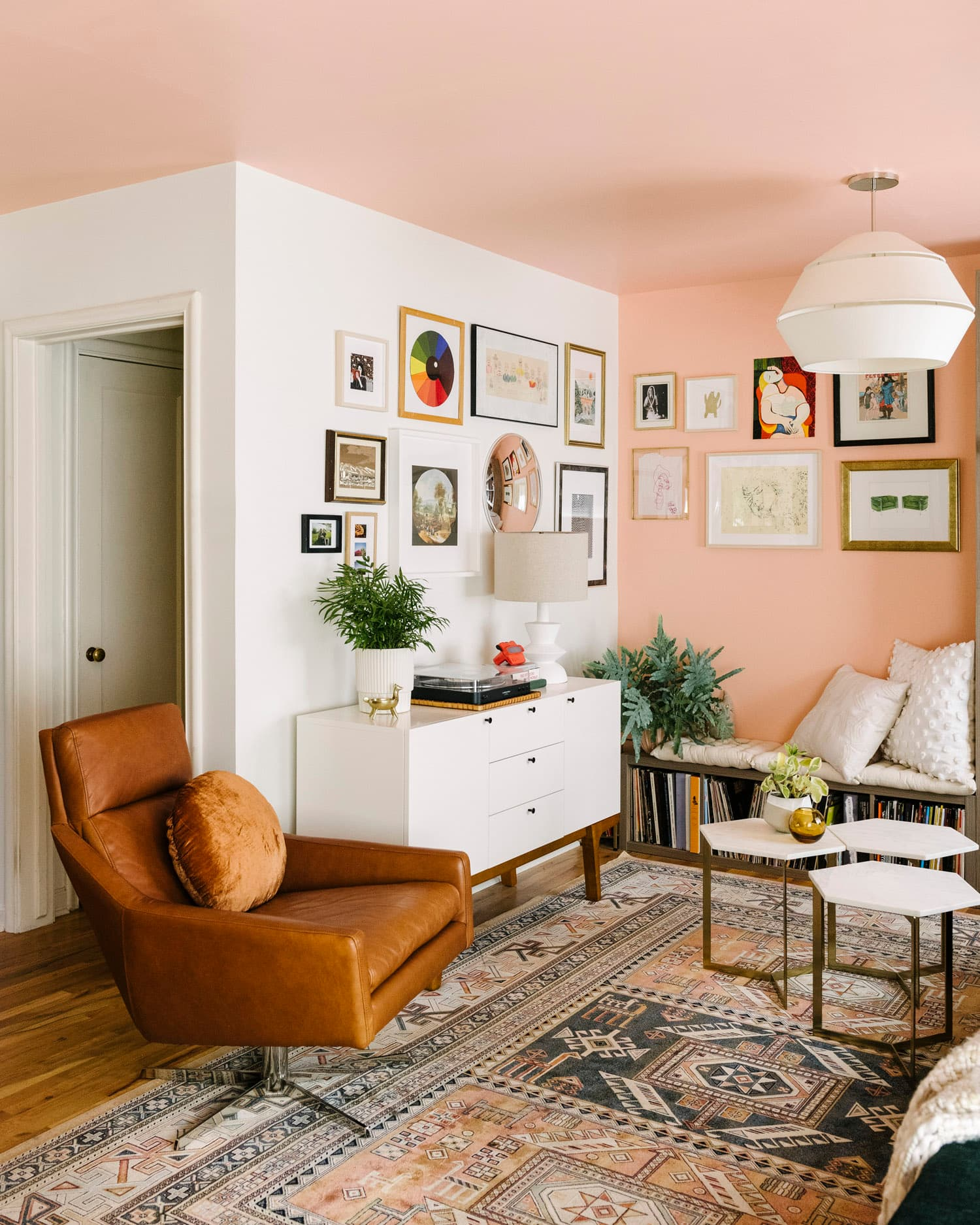 this is a mid century modern living room with coral colour palette