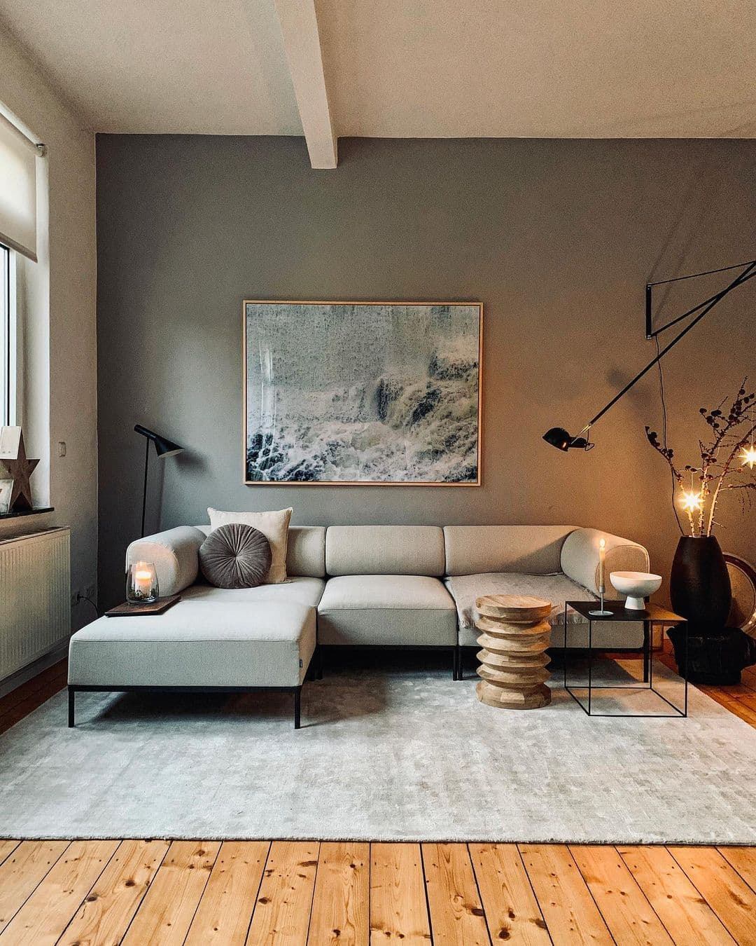 this is a mid century modern living room with dark grey