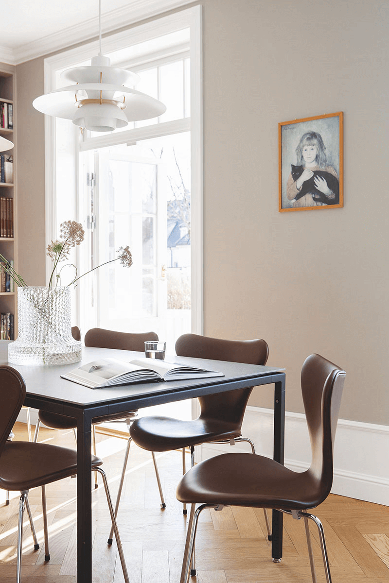 this is a Scandinavian dining room showcasing a gallery wall, a classic Scandinavian interior addition