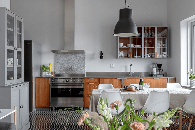 this is a Scandinavian Home with geometric tiles, wooden shelves and tables and chairs