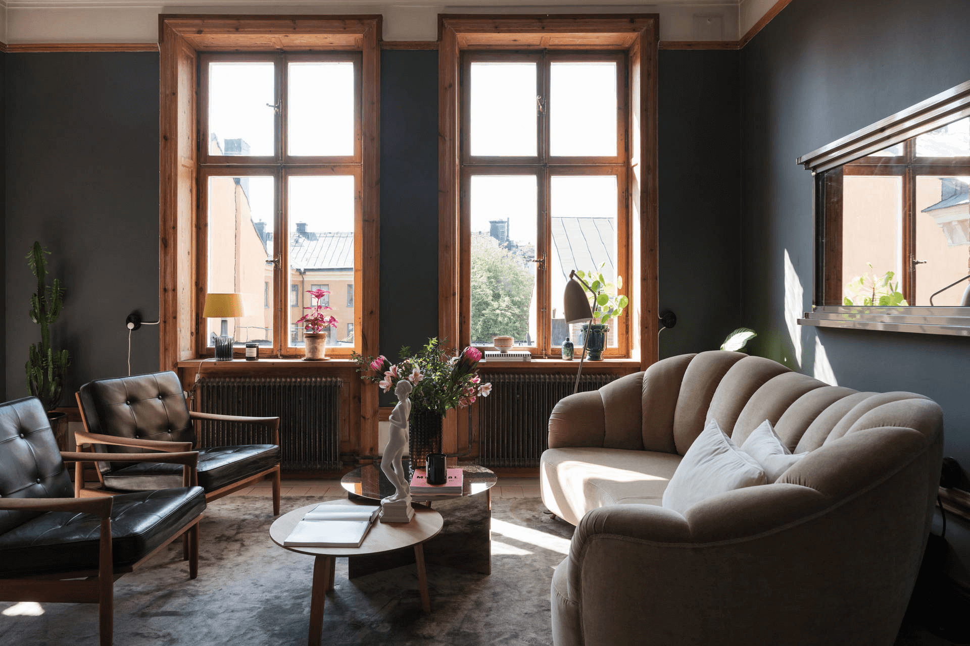 this is a Scandinavian styled apartment with minimal and clean designs with a blend of wooden accents
