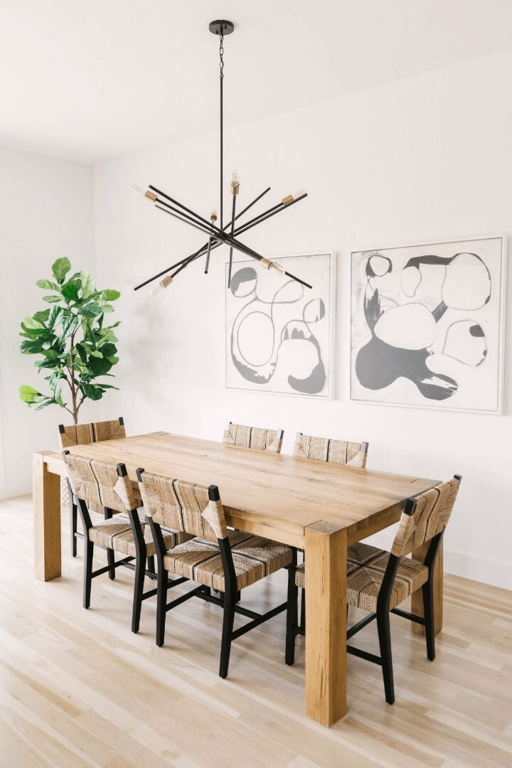 this is a classic farmhouse dining table with chairs and contemporary feel with lights and indoor plant on show(1)