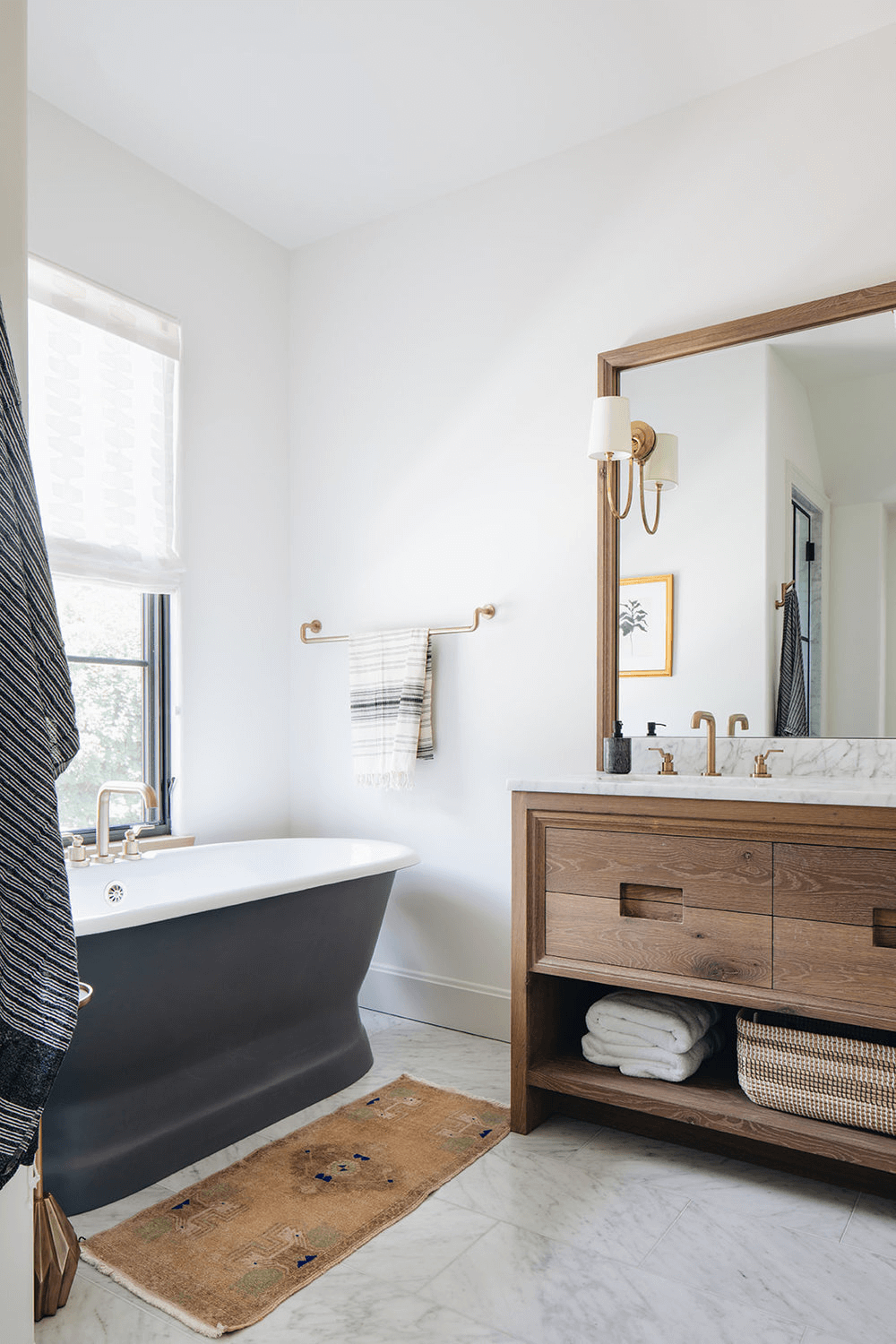this is a farmhouse bathroom with bronze details dark wooden vanity cabinets(1)