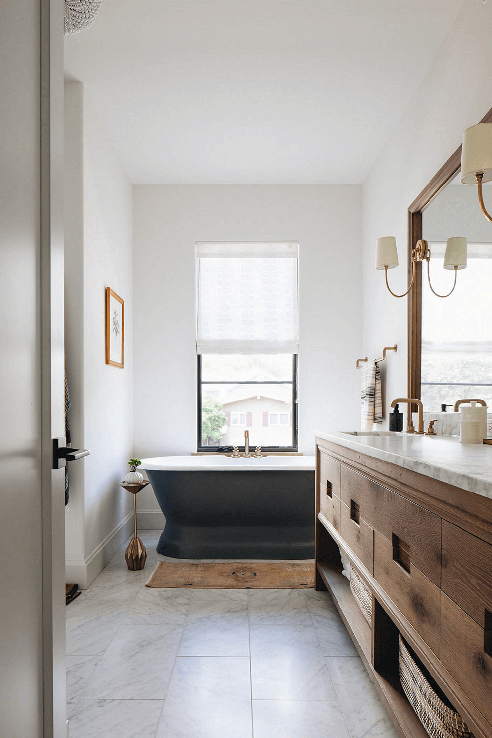 this is a farmhouse bathroom with claw foot bathtub, with stripped textile blinds(1)