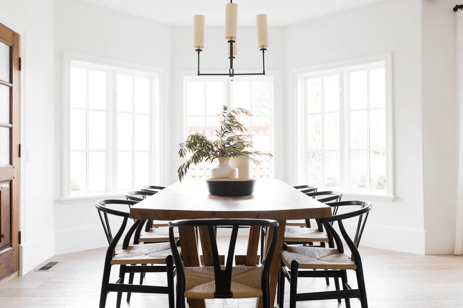 this is a farmhouse dining room with Antique Chandeliers(1)