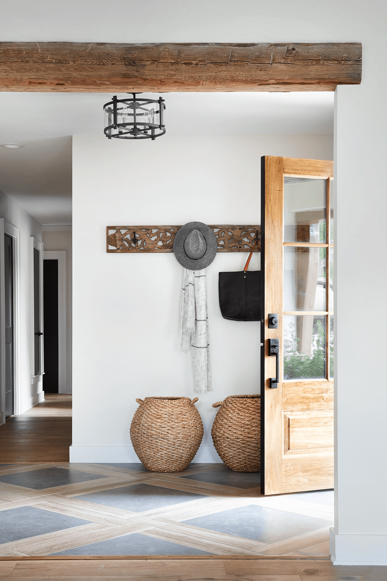 this is a farmhouse entryway with tiled flooring and wooden beams(1)