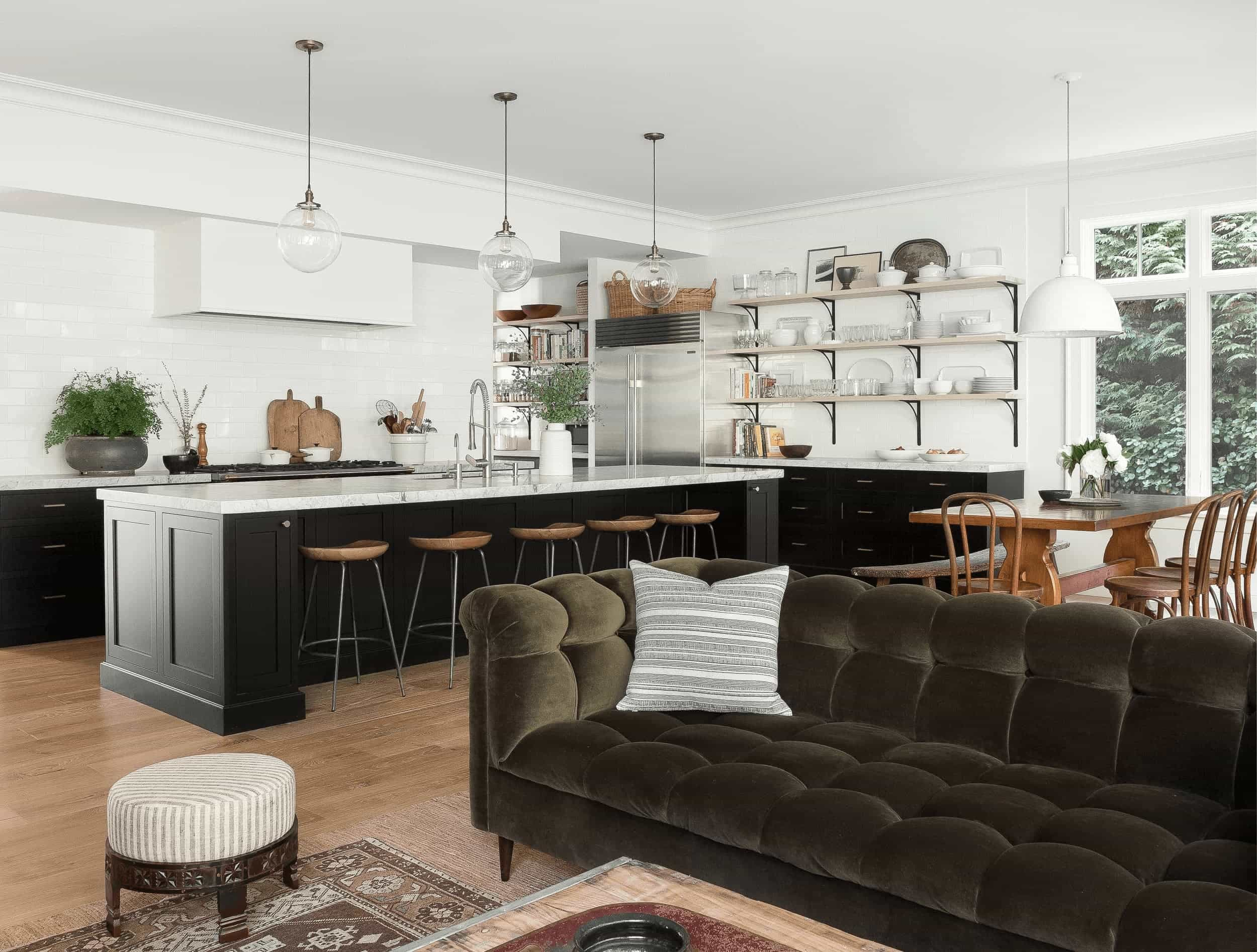 this is a farmhouse kitchen and living room with bar stools, wooden shelves and marble kitchen bar