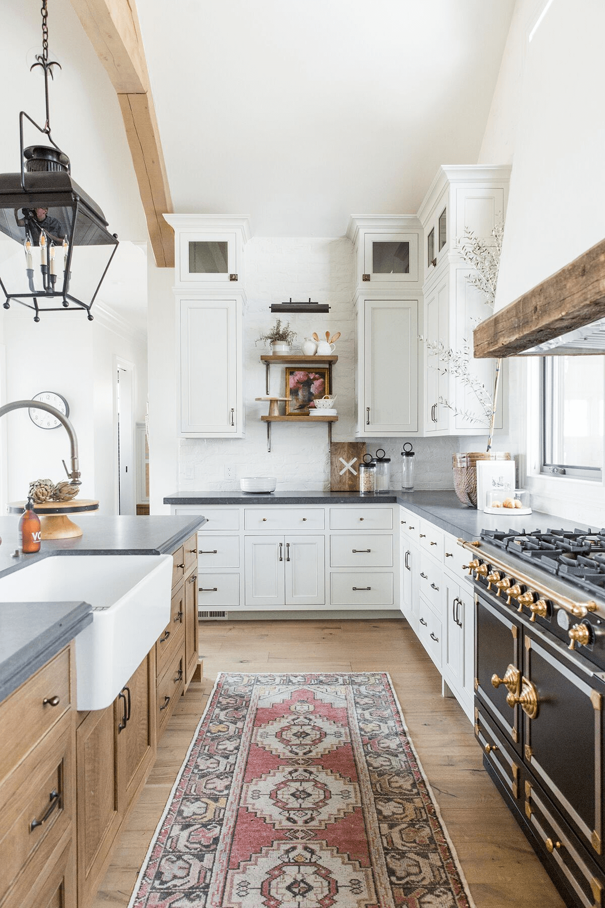 this is a farmhouse kitchen with a white apron sink and wooden cabinets(1)