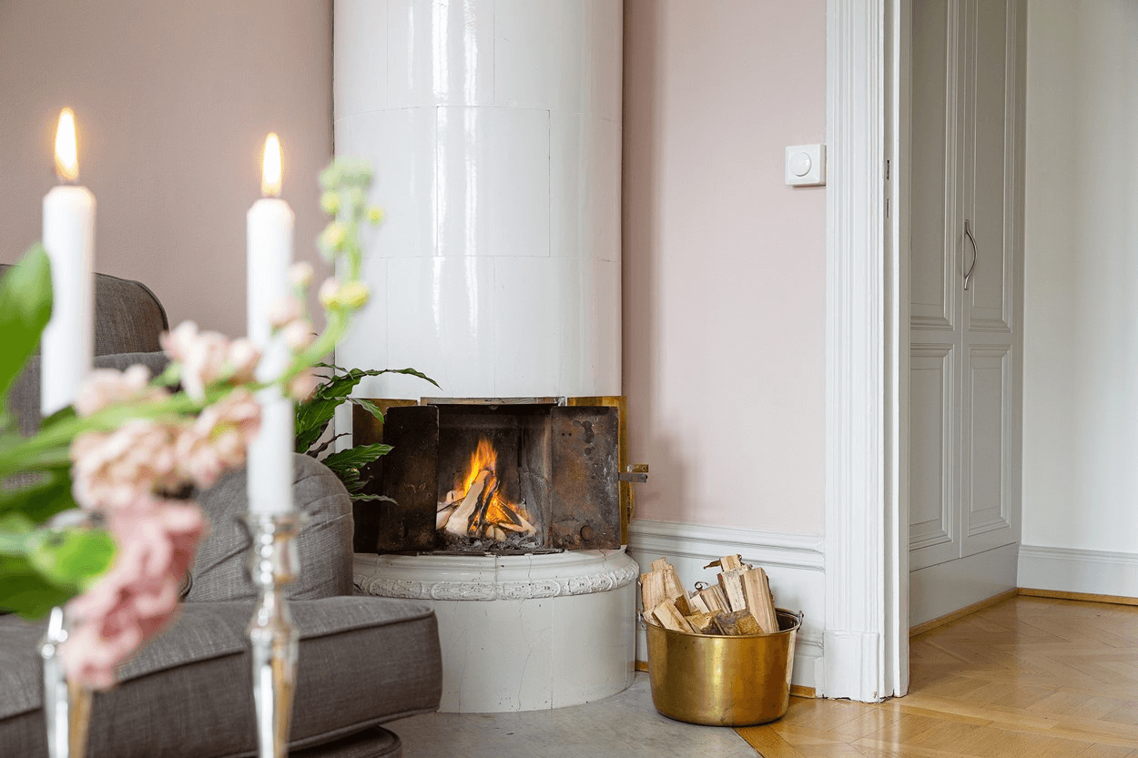 this is a minimal Scandinavian styled apartment with a fireplace in show