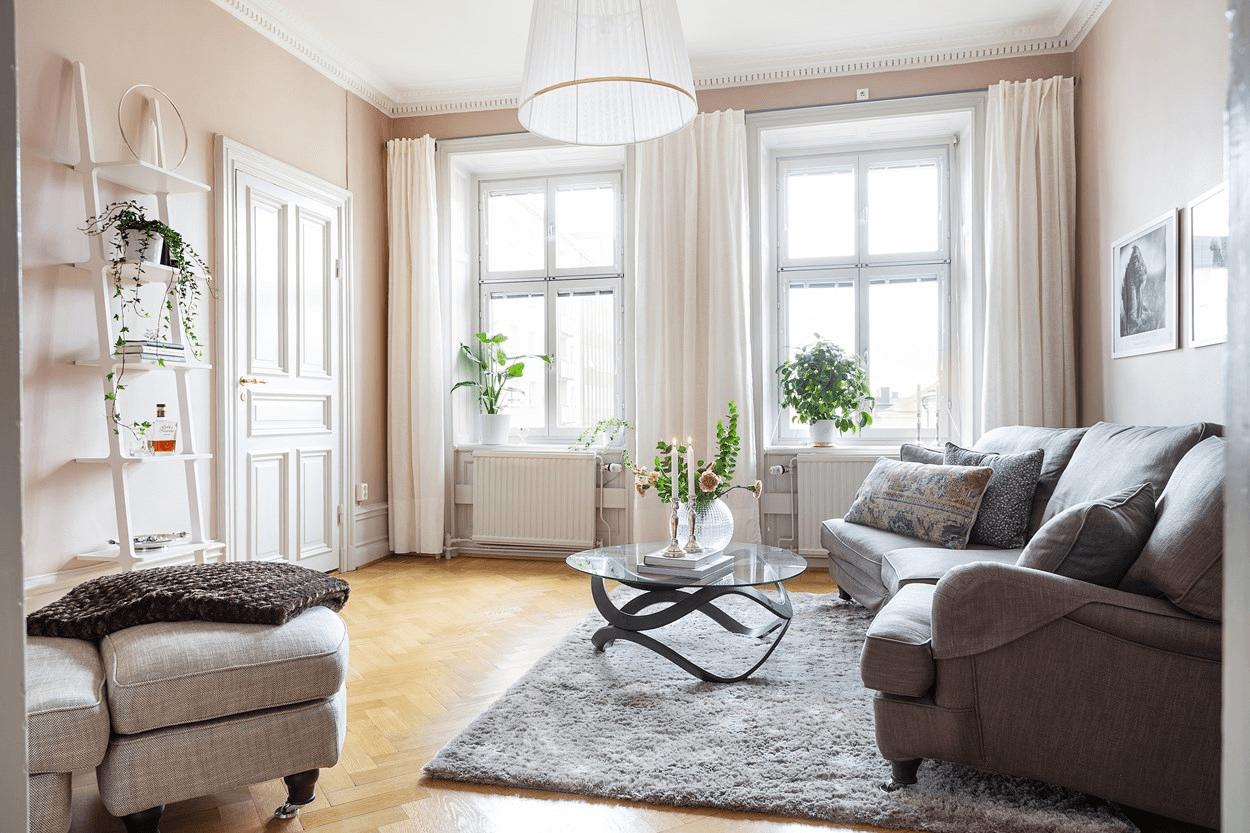 this is a minimal Scandinavian styled apartment with shades of pink and incoming natural light