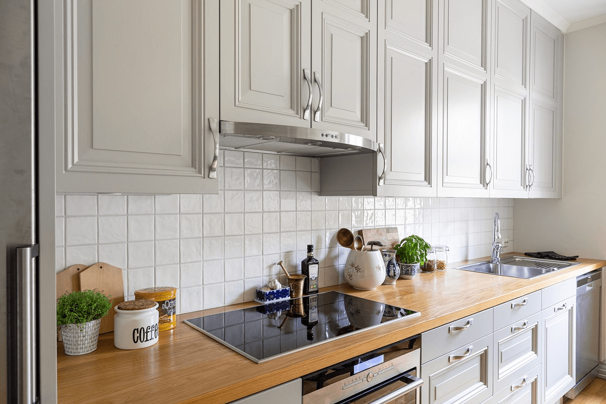 this is a minimal Scandinavian styled kitchen with rock salt grey cabinets