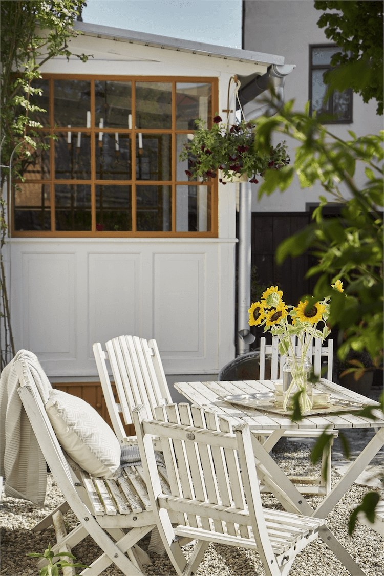 this is a outside a Scandinavian home with a focus on the distressed look with tables and chairs outside(1)