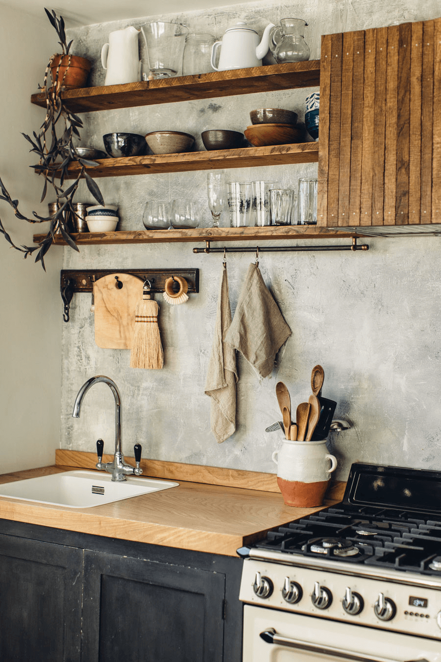 this is a rustic look Scandinavian kitchen with wooden shelves and a arga oven(1)