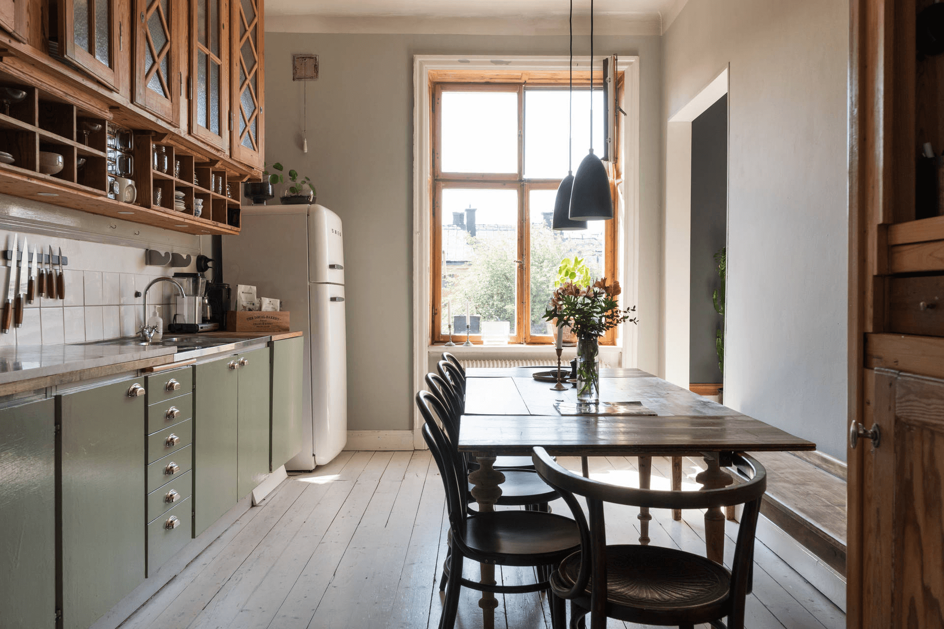 this is a scandinavian and minimal design kitchen with smeg fridge and wooden cabinets