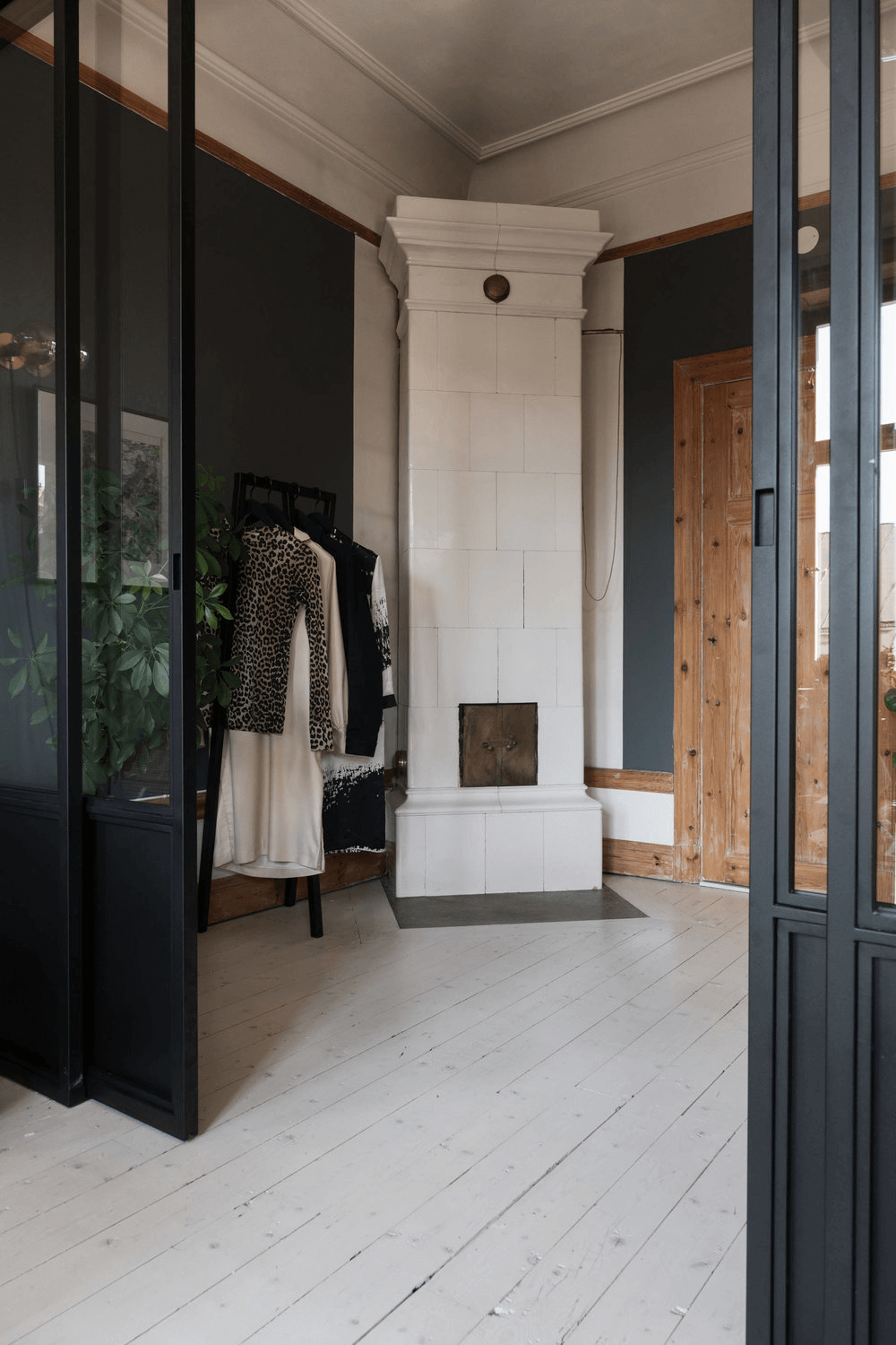 this is a wooden styled Scandinavian apartment with a white stone fireplace