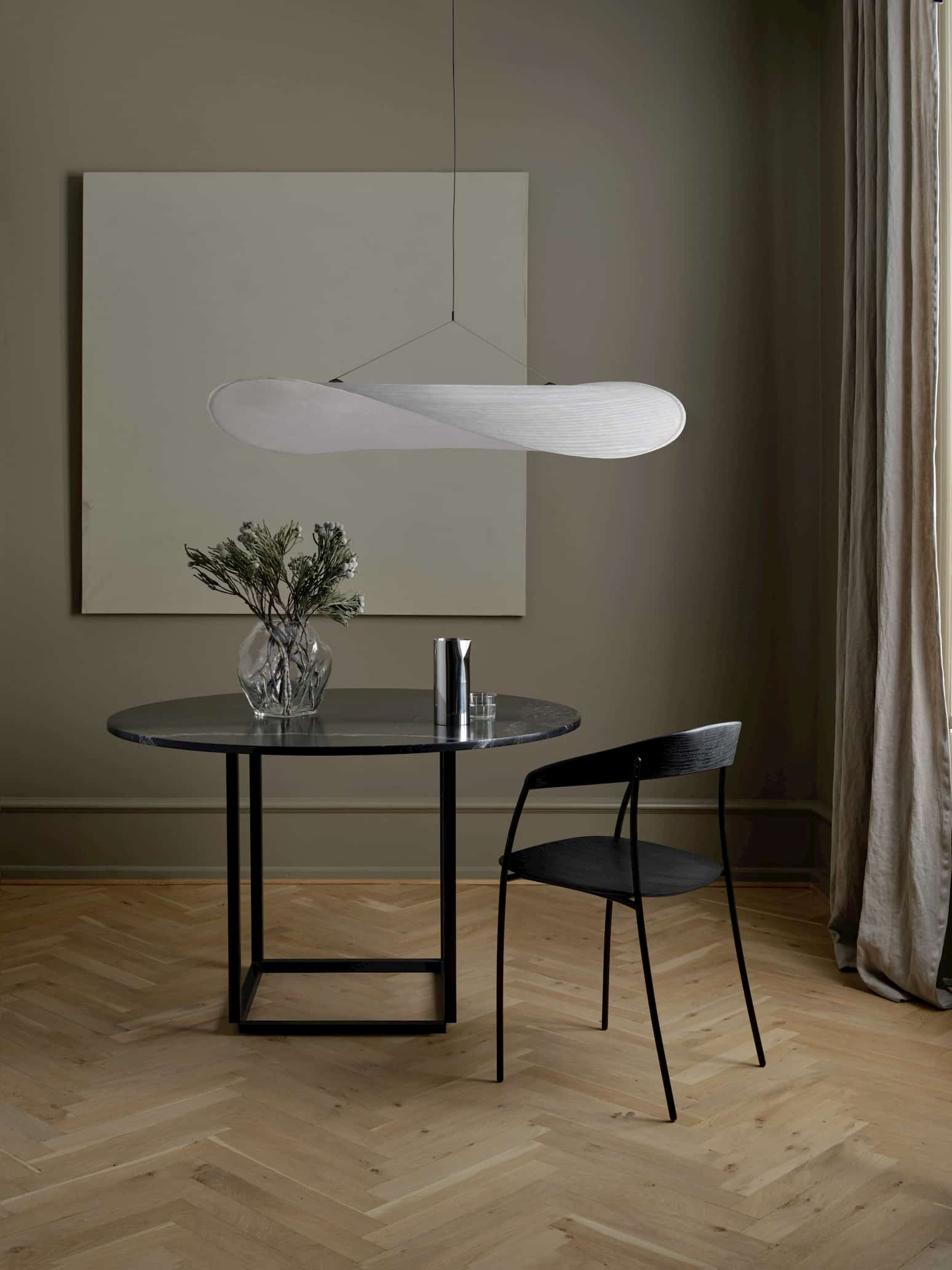 this is an artist white pendant and office chair made by New Works