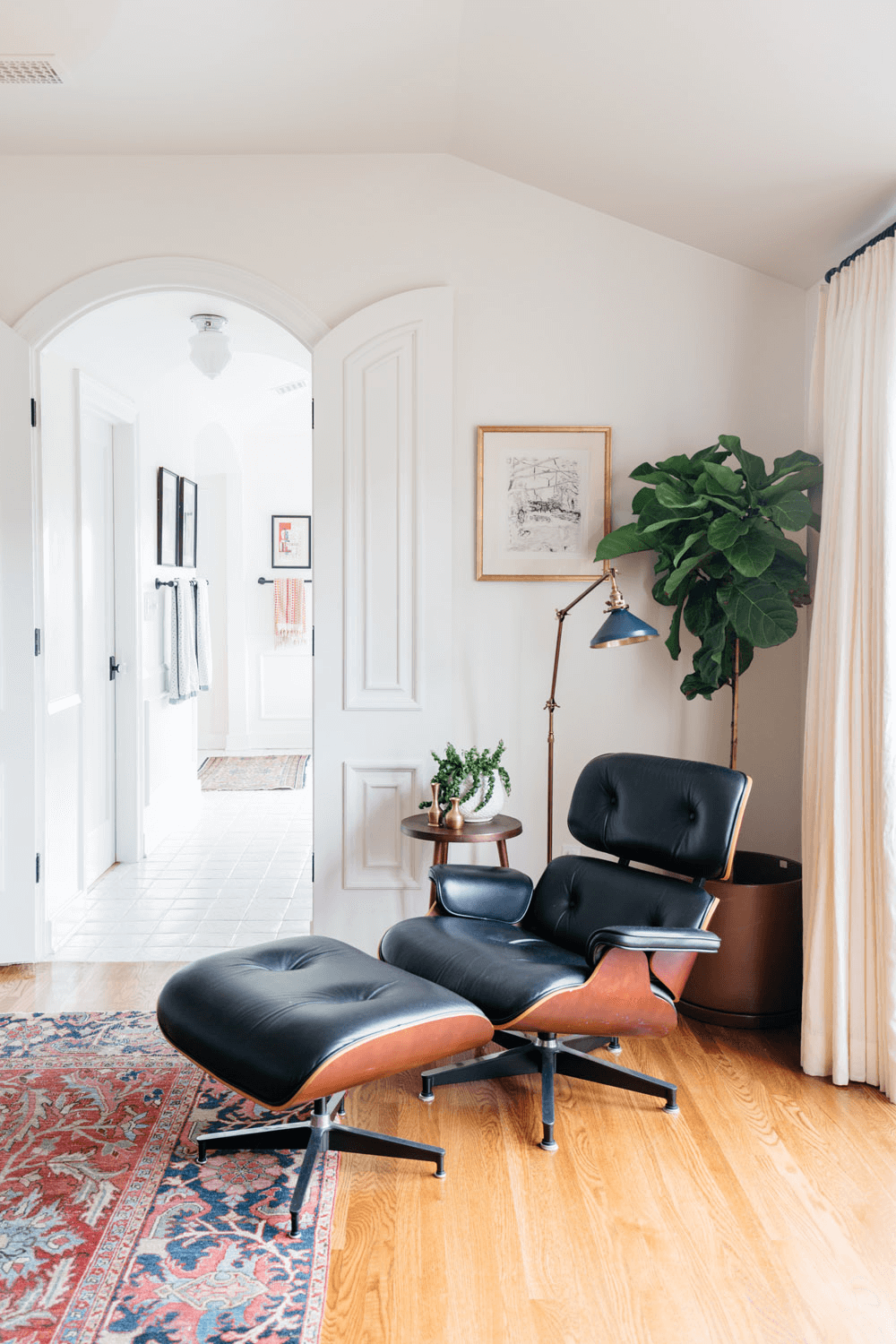 this is a Eames Lounge Chair and Ottoman was designed in 1956 by Charles and Ray Eames