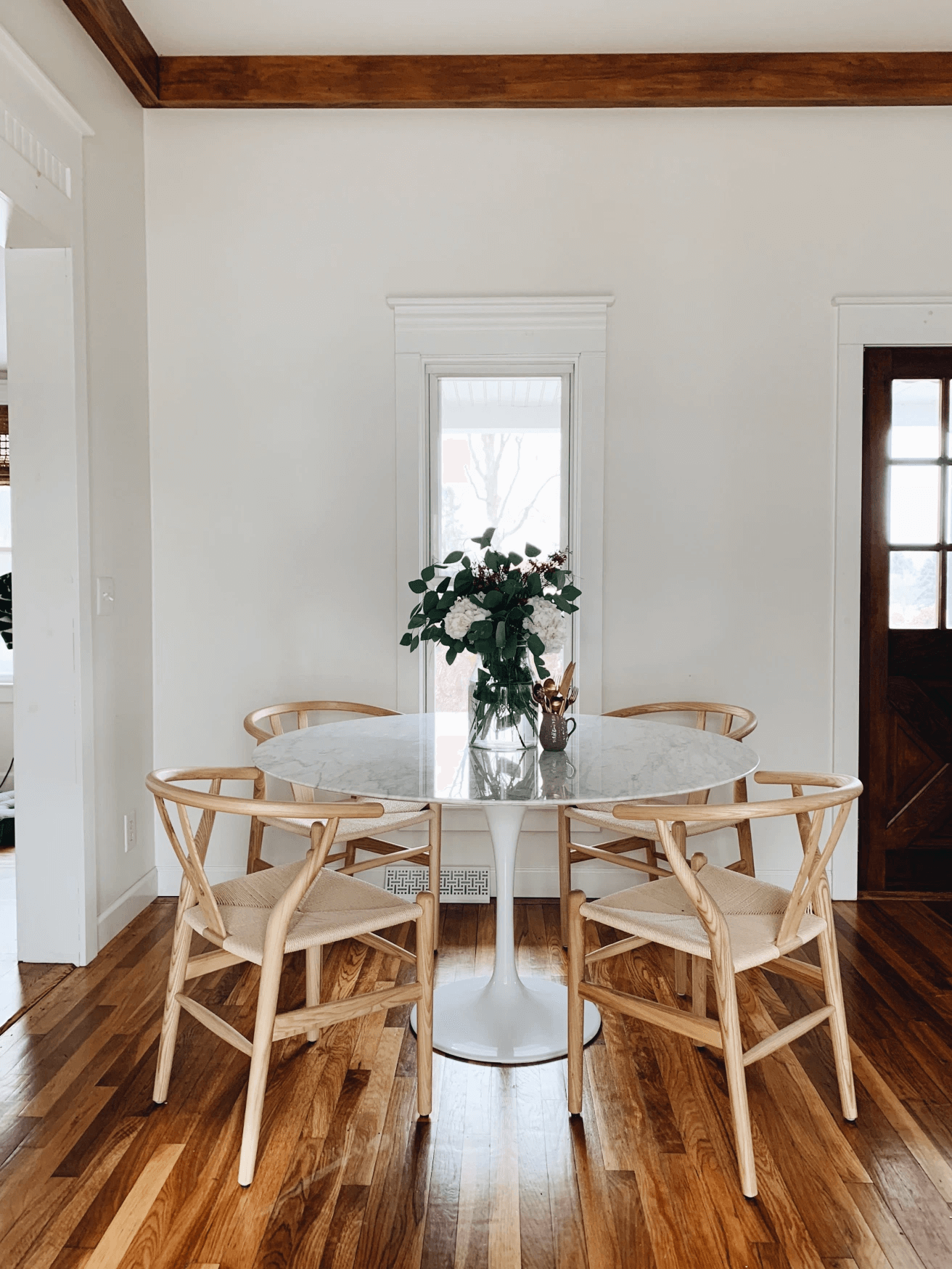 this is a mid century inspired dining table with wishbone chairs