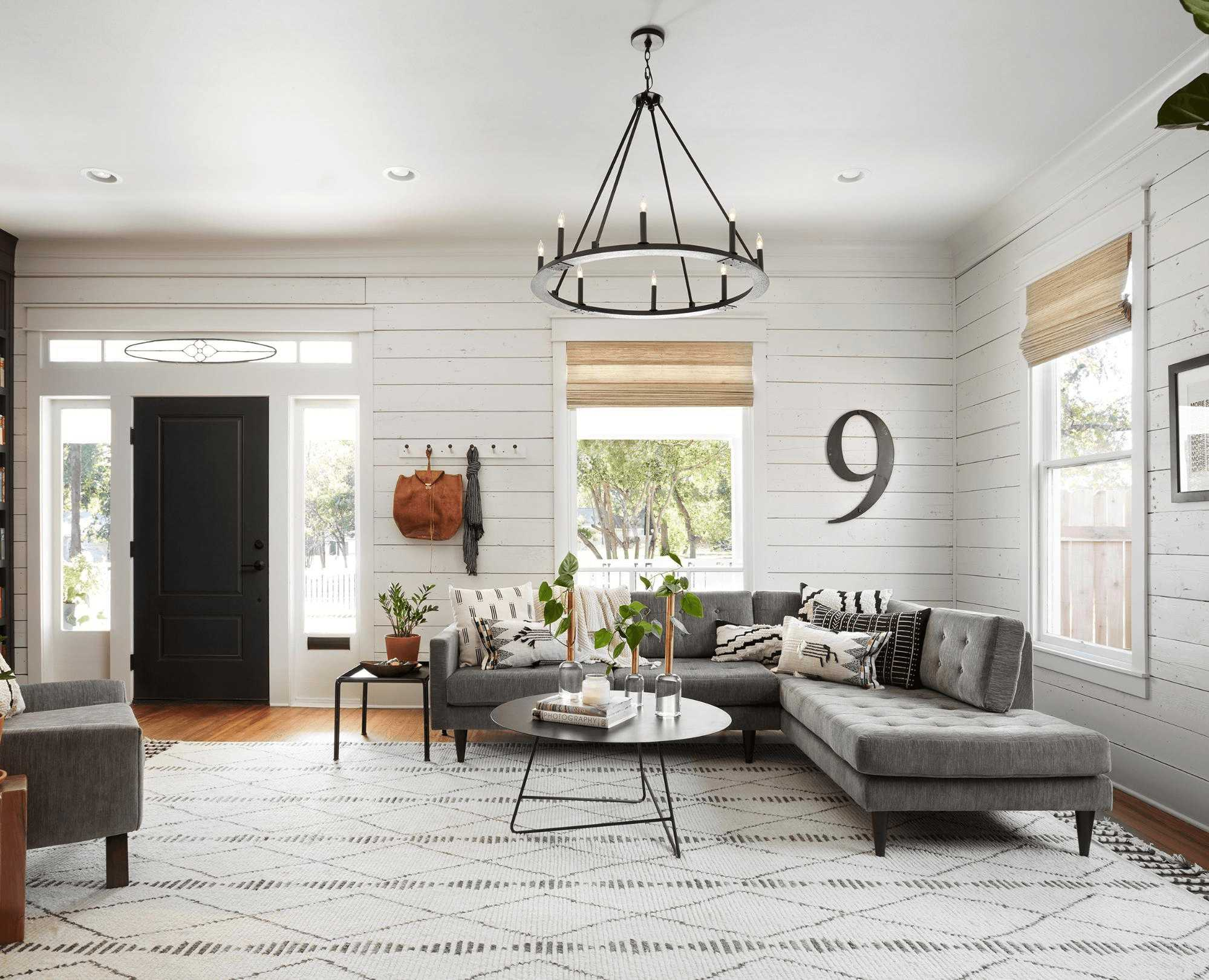this-is-a-farmhouse-living-room-with-shiplap-walls-1