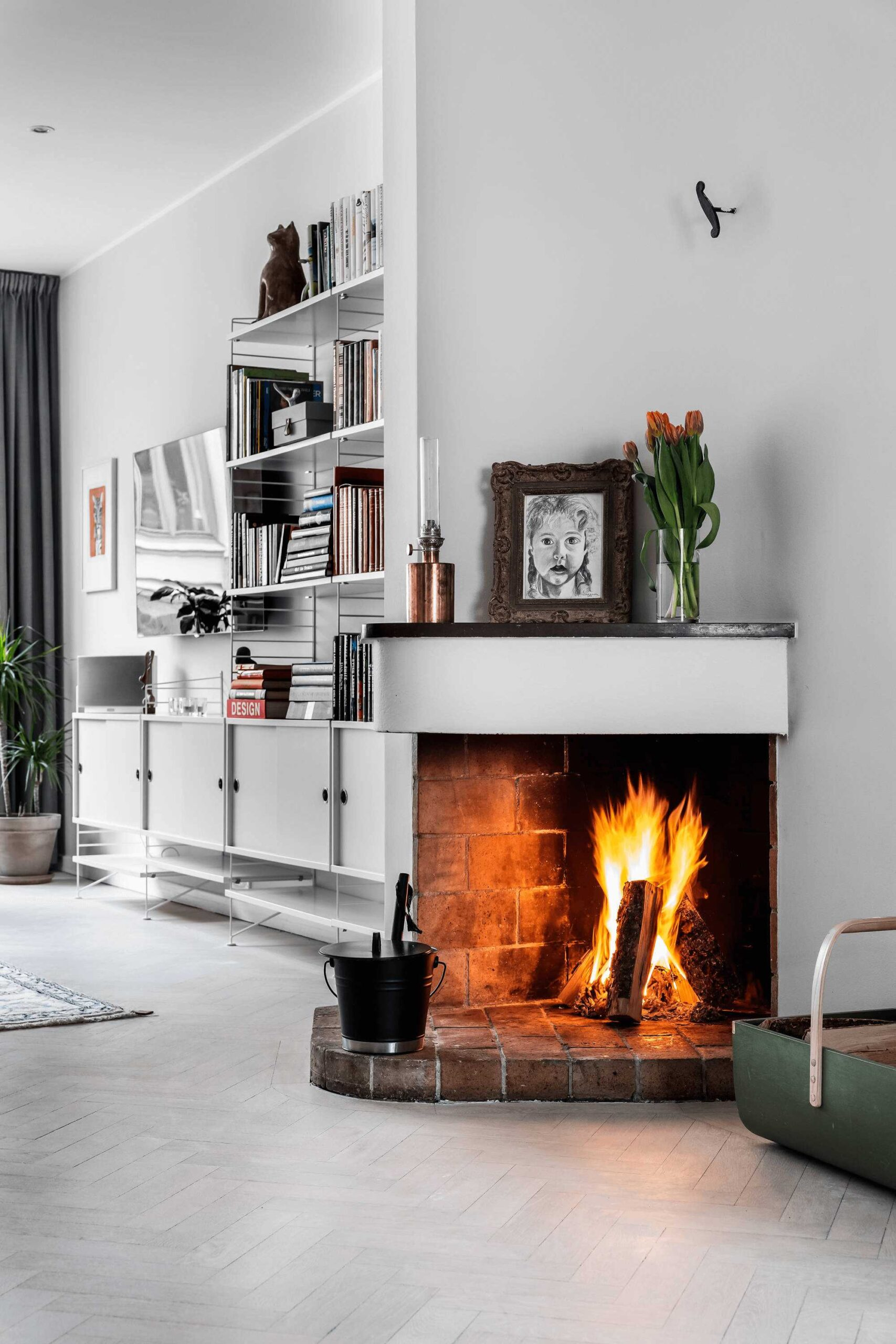 this-is-a-fireplace-in-an-apartment-with-ornaments-on-show