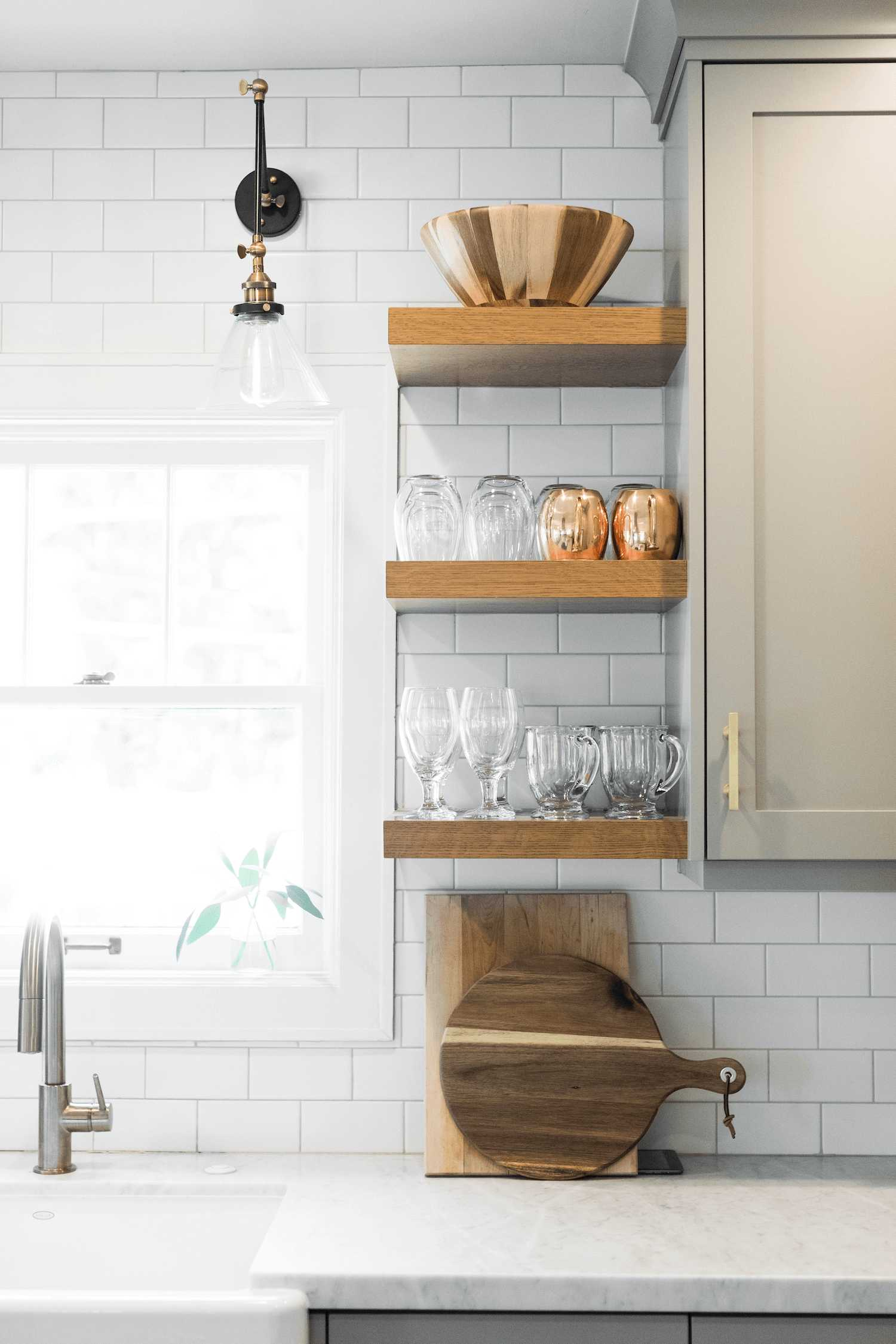 this-is-a-coastal-farmhouse-kitchen-with-marble-kitchen-island.png