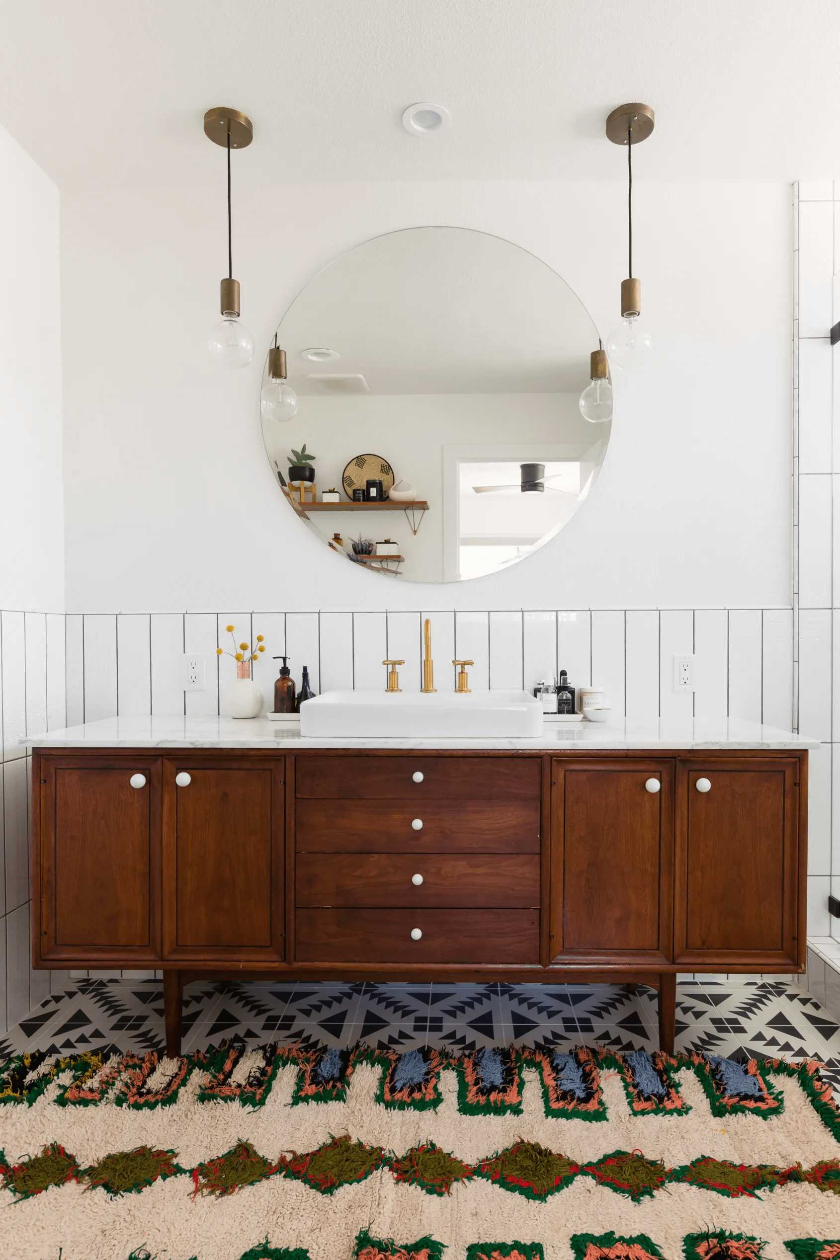 this-is-a-vintage-dark-wooden-cabinet-with-a-statement-mirror-and-apron-sink-in-sight