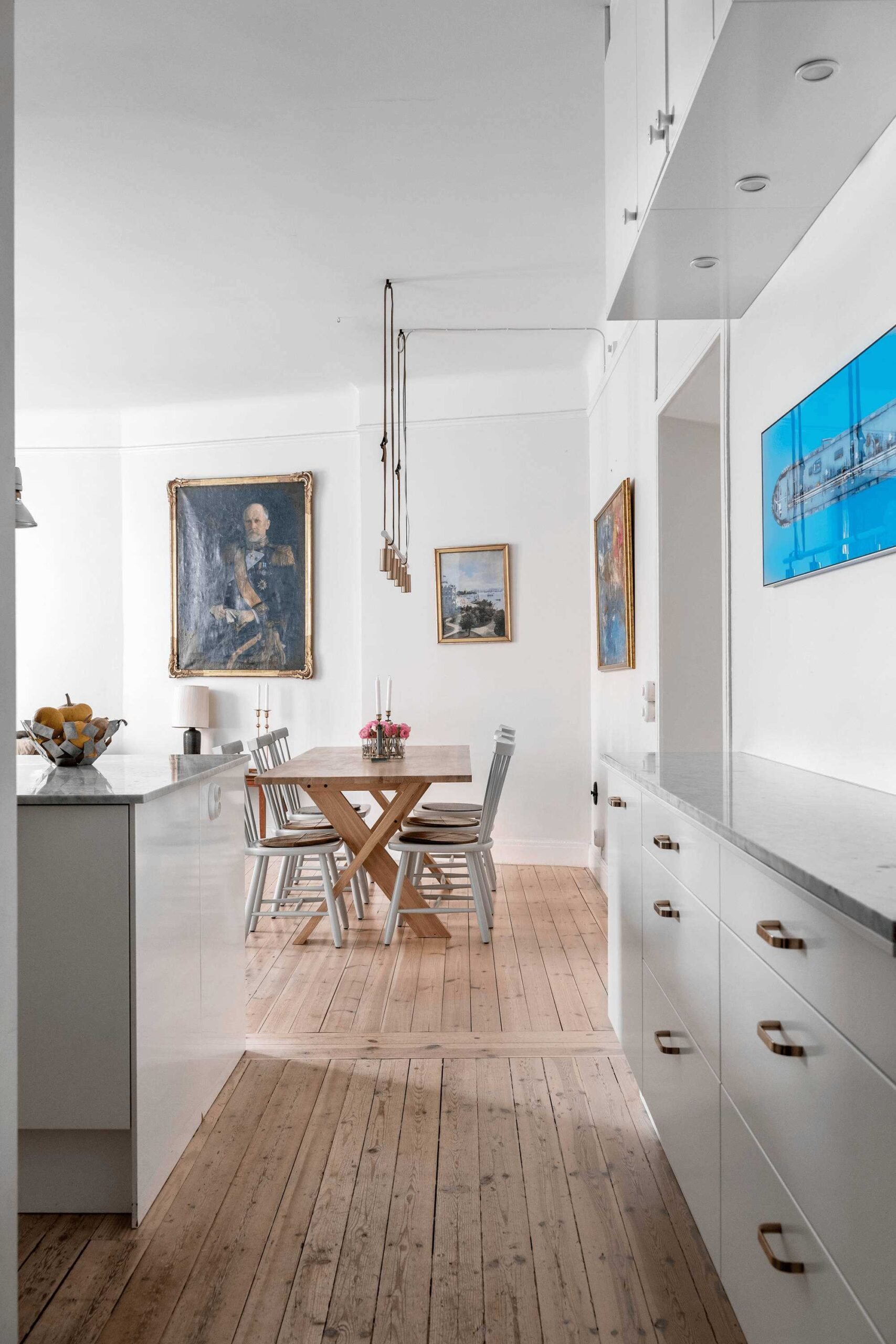 this-is-art-inspired-Scandinavian-style-apartment-with-wooden-floors-art-on-the-wall-and-tables-and-chairs