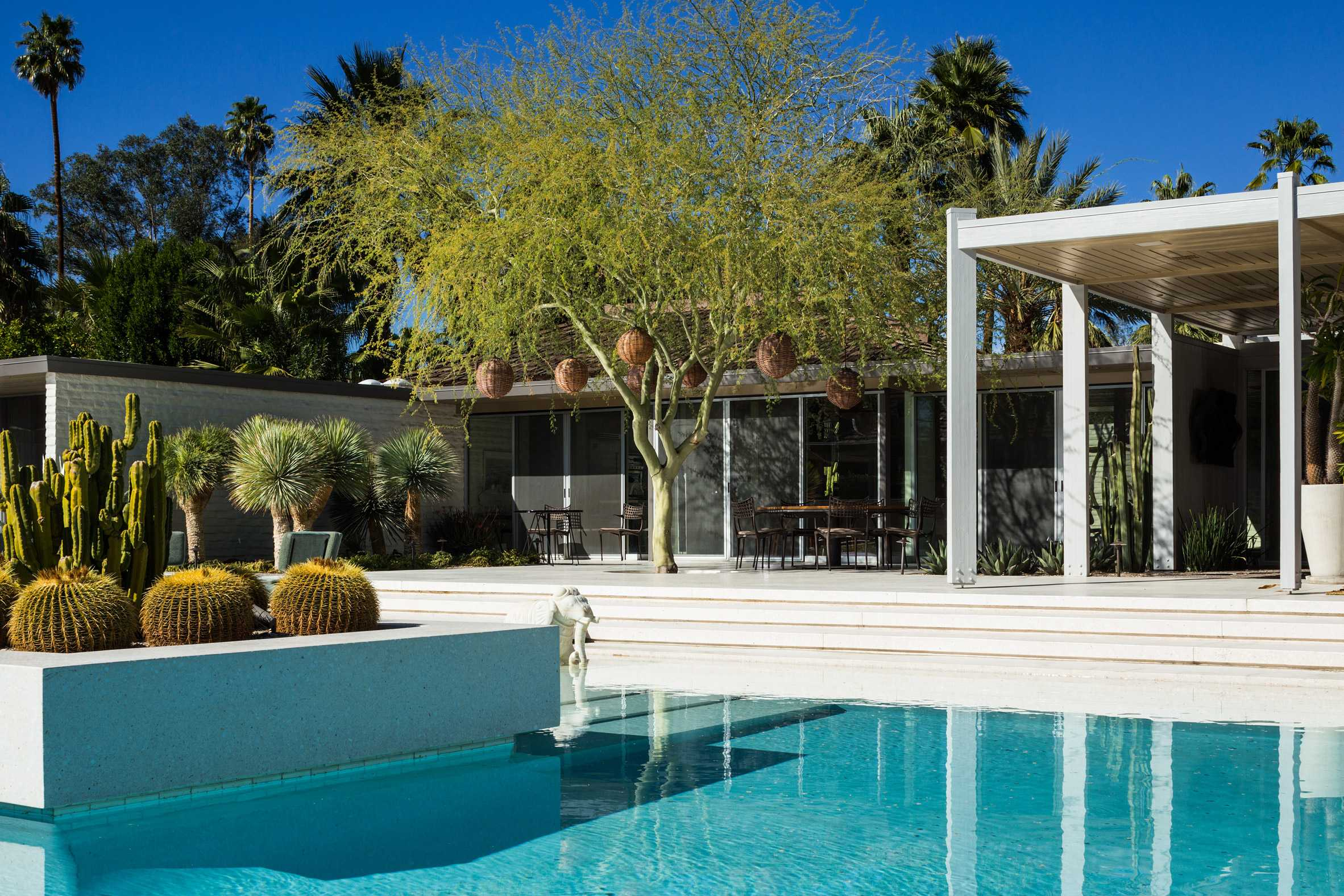 this-is-the-Abernathy-Residence-located-in-Palm-Springs-showing-the-outside-swimming-pool-and-view-of-the-classic-mid-century-modern-design