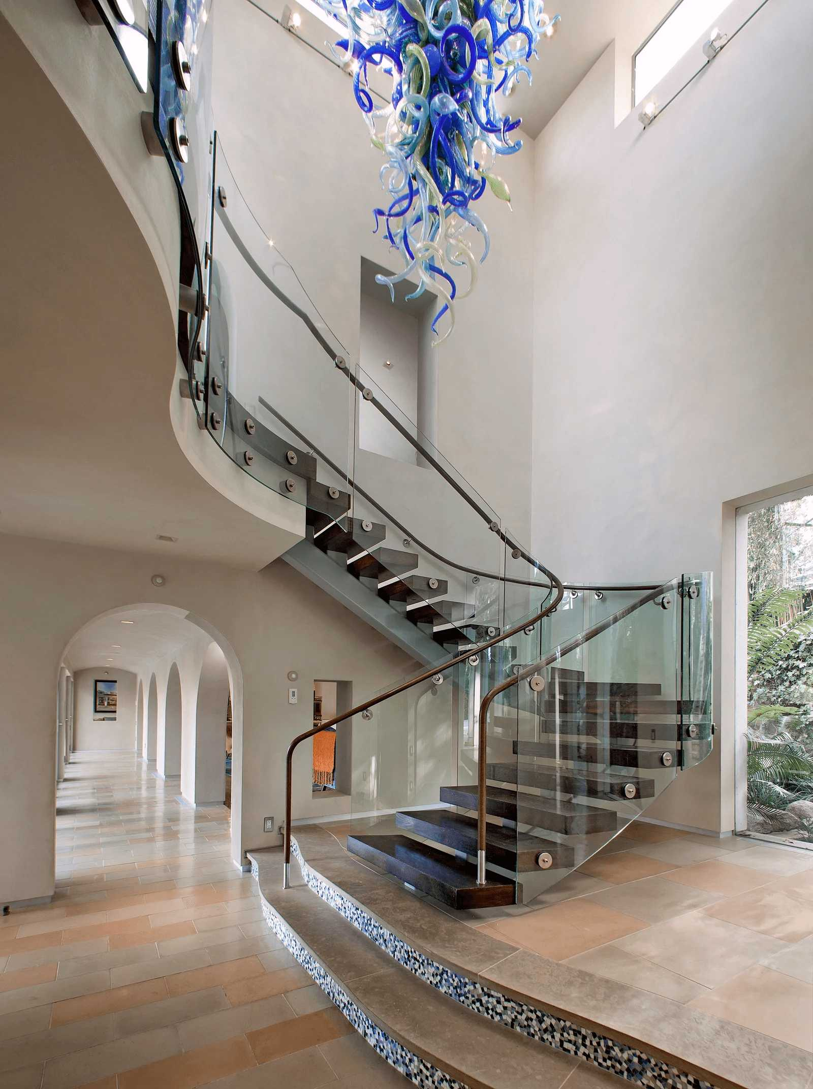this-is-the-Bailey-House-a-look-into-the-curved-glass-staircase-from-inside-the-mid-century-modern-home-in-LA