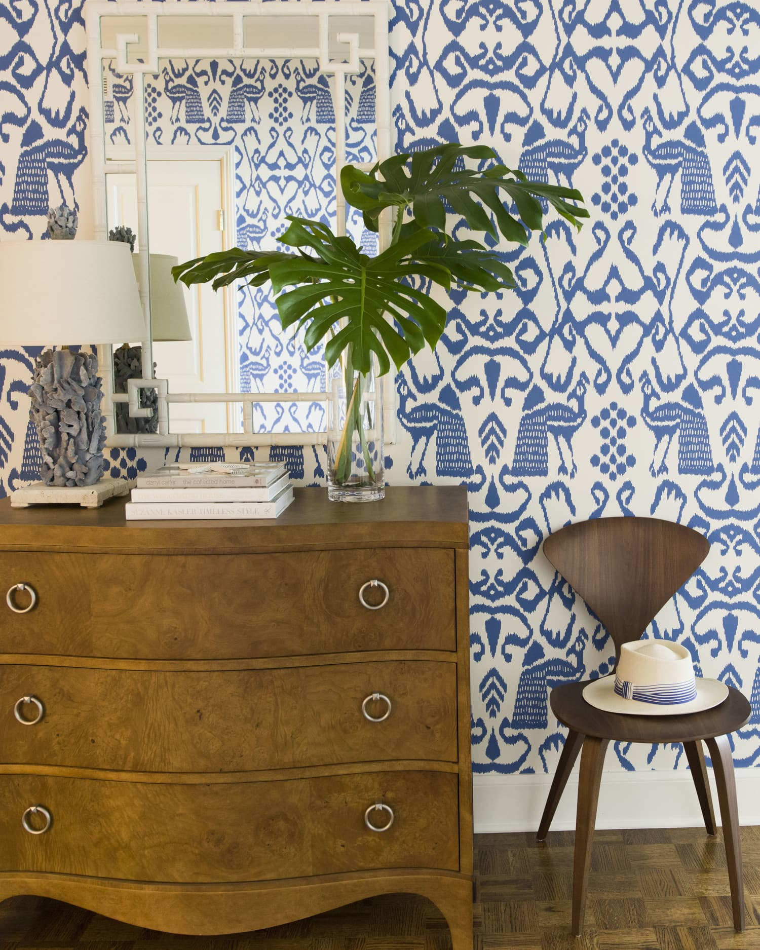 this is a bedroom with an abstract wallpaper of wildlife