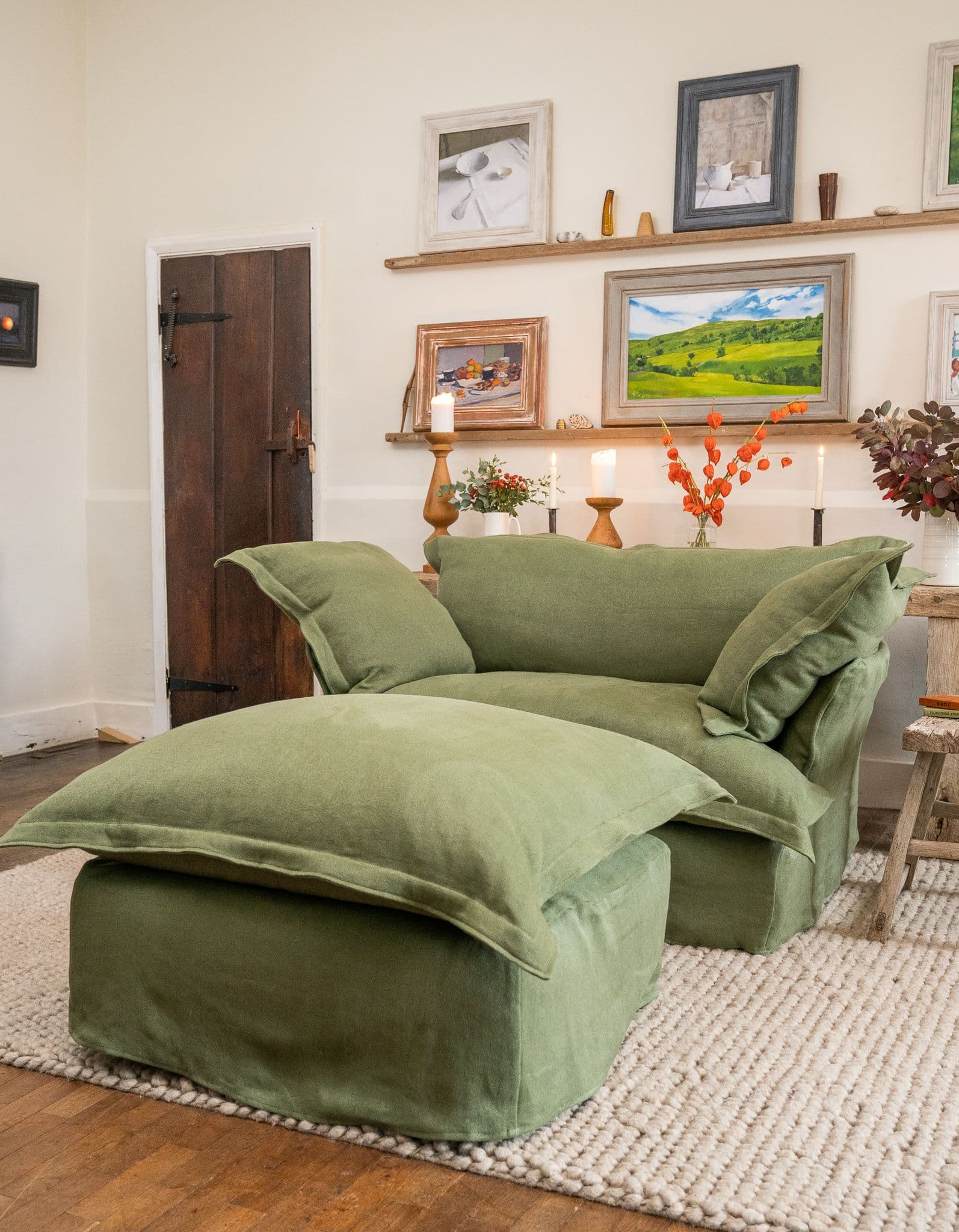 this is a linen shabby chic love seat with a footstool by maker and son
