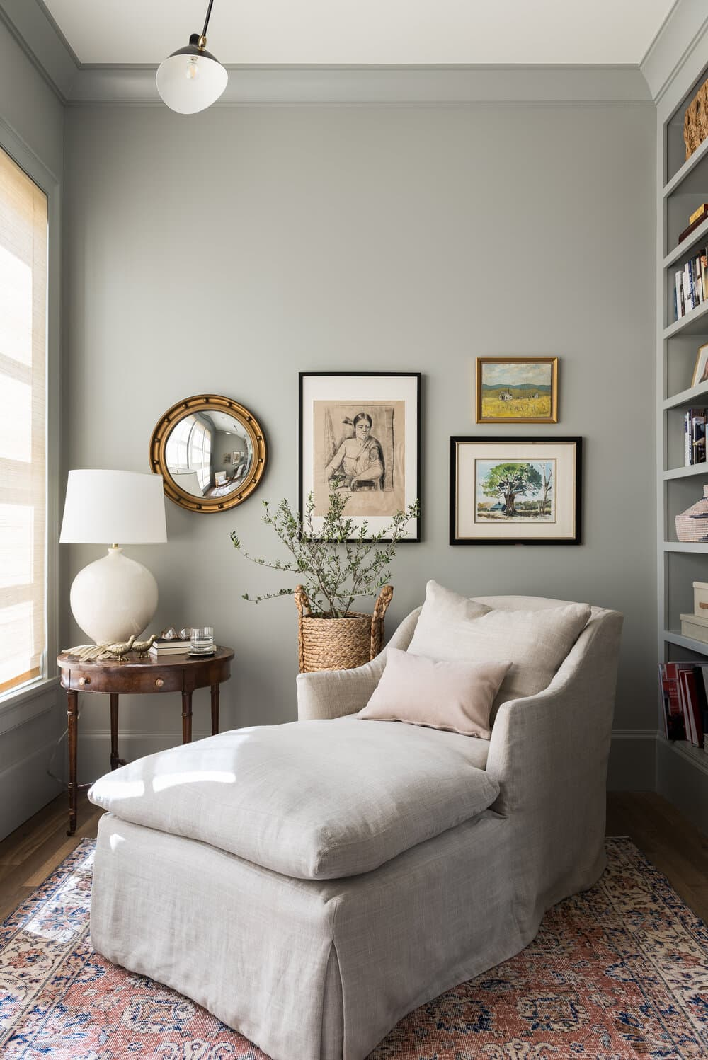 this is a reading nook with a gallery wall and grey colour scheme
