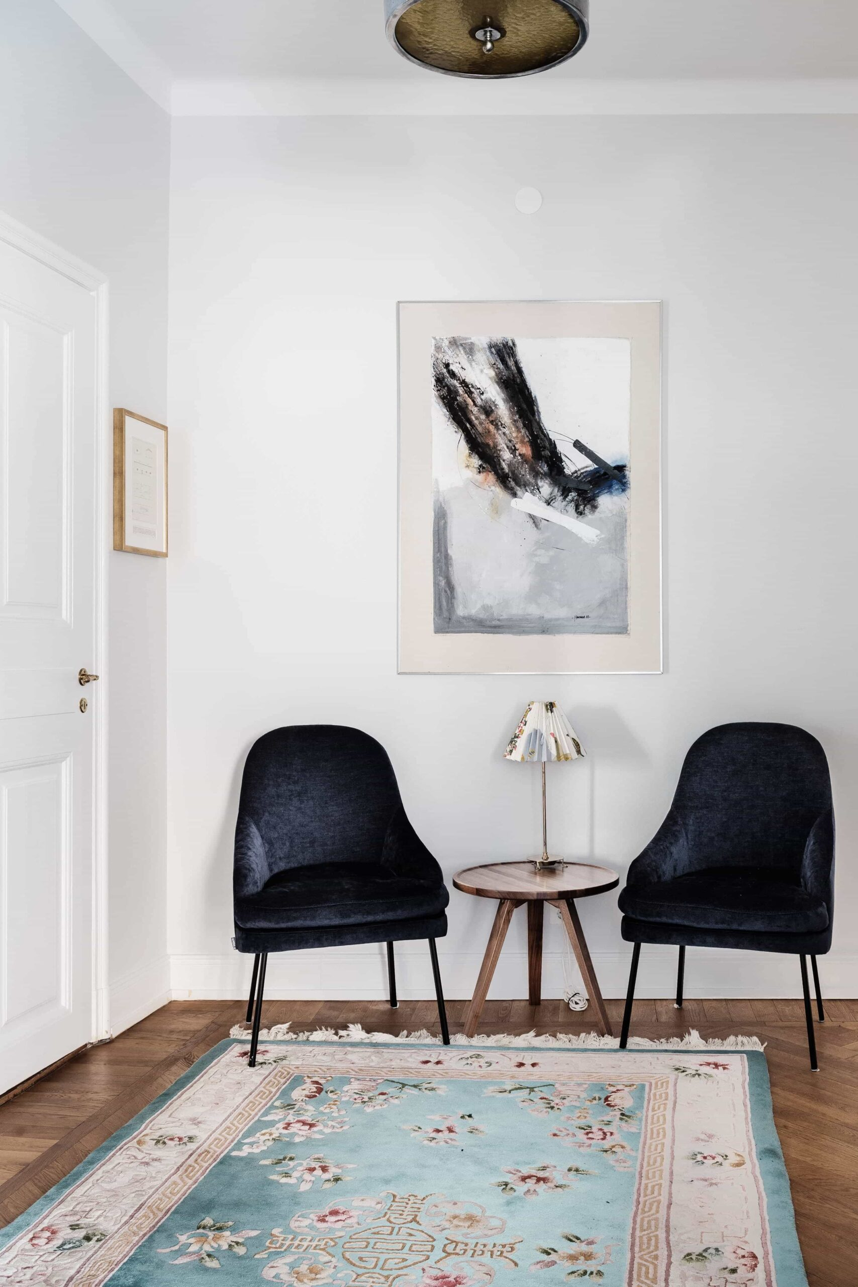 this is a scandianvian apartment with vintage elements such as a rug