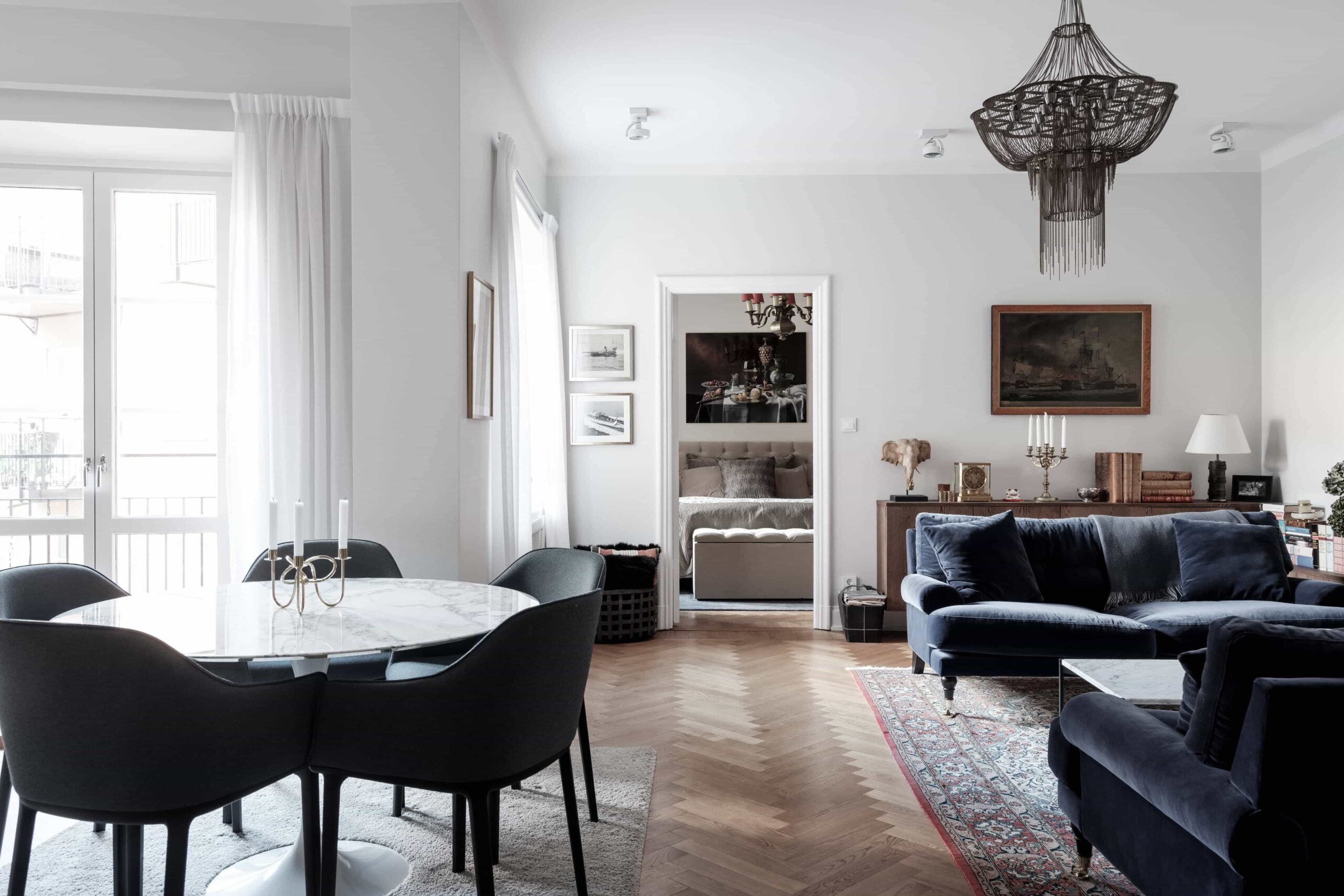 this is a scandinavian apartment with blue velvet dining chairs and vintage elements