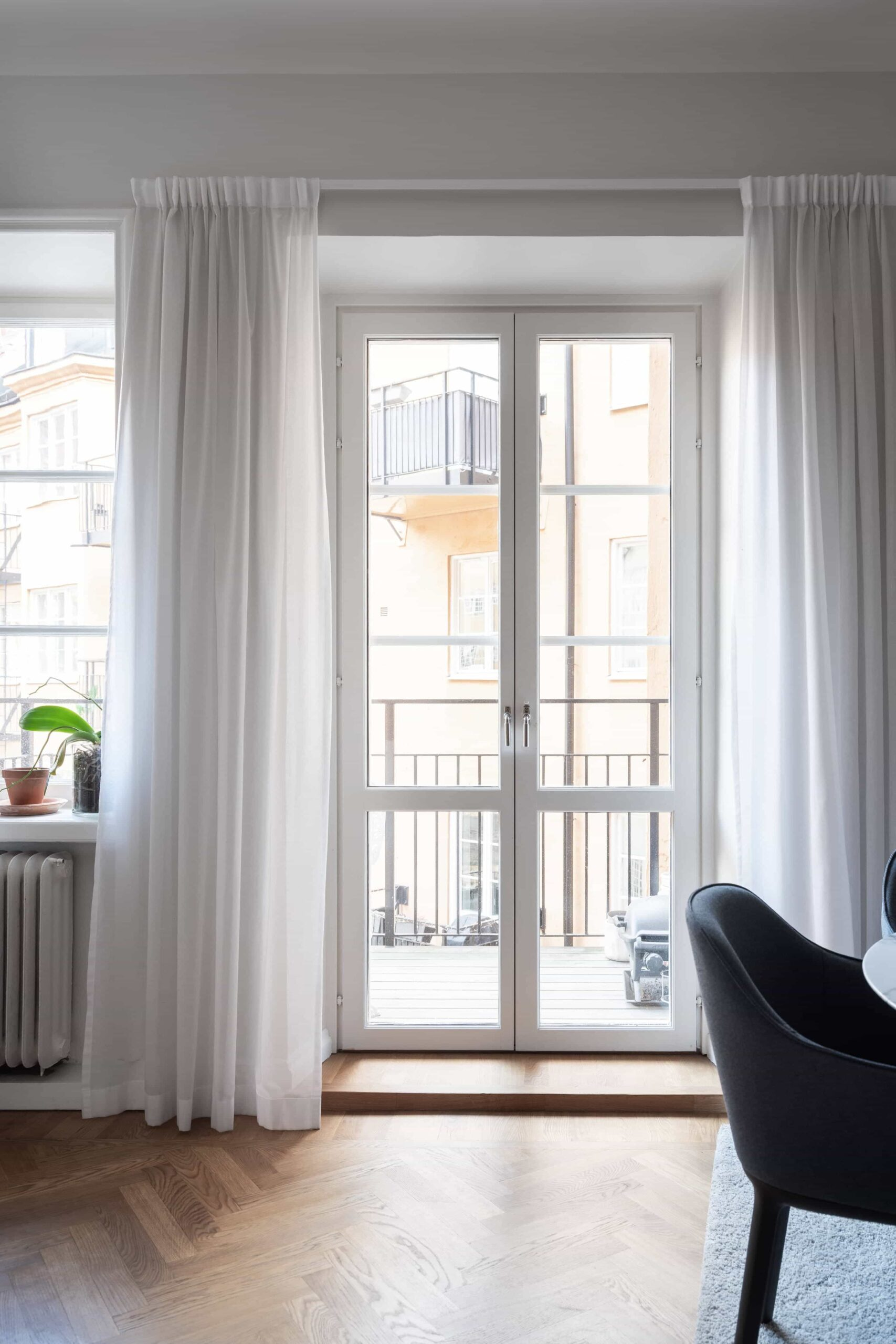 this is a scandinavian apartment with linen curtains