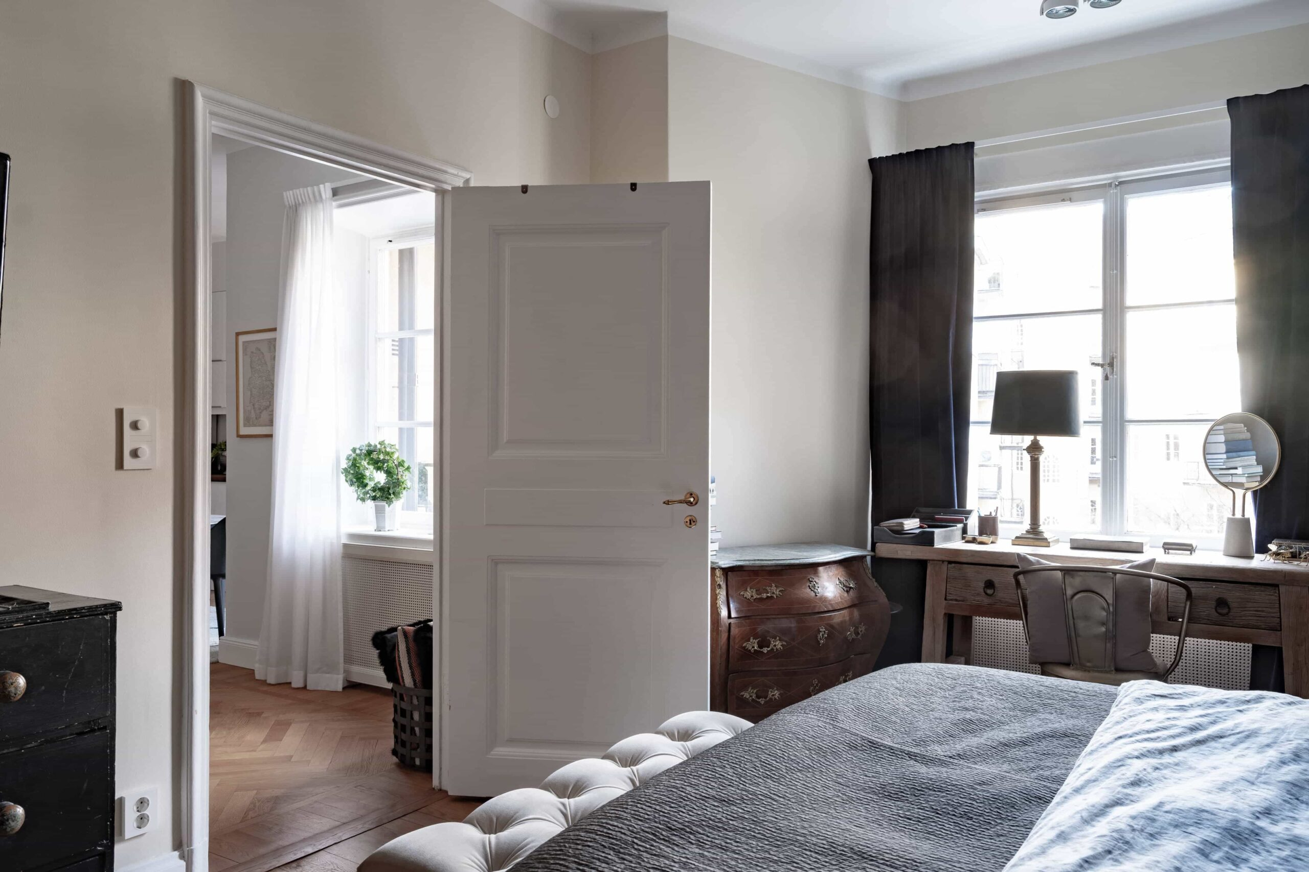 this is a scandinavian bedroom with white and blue colours