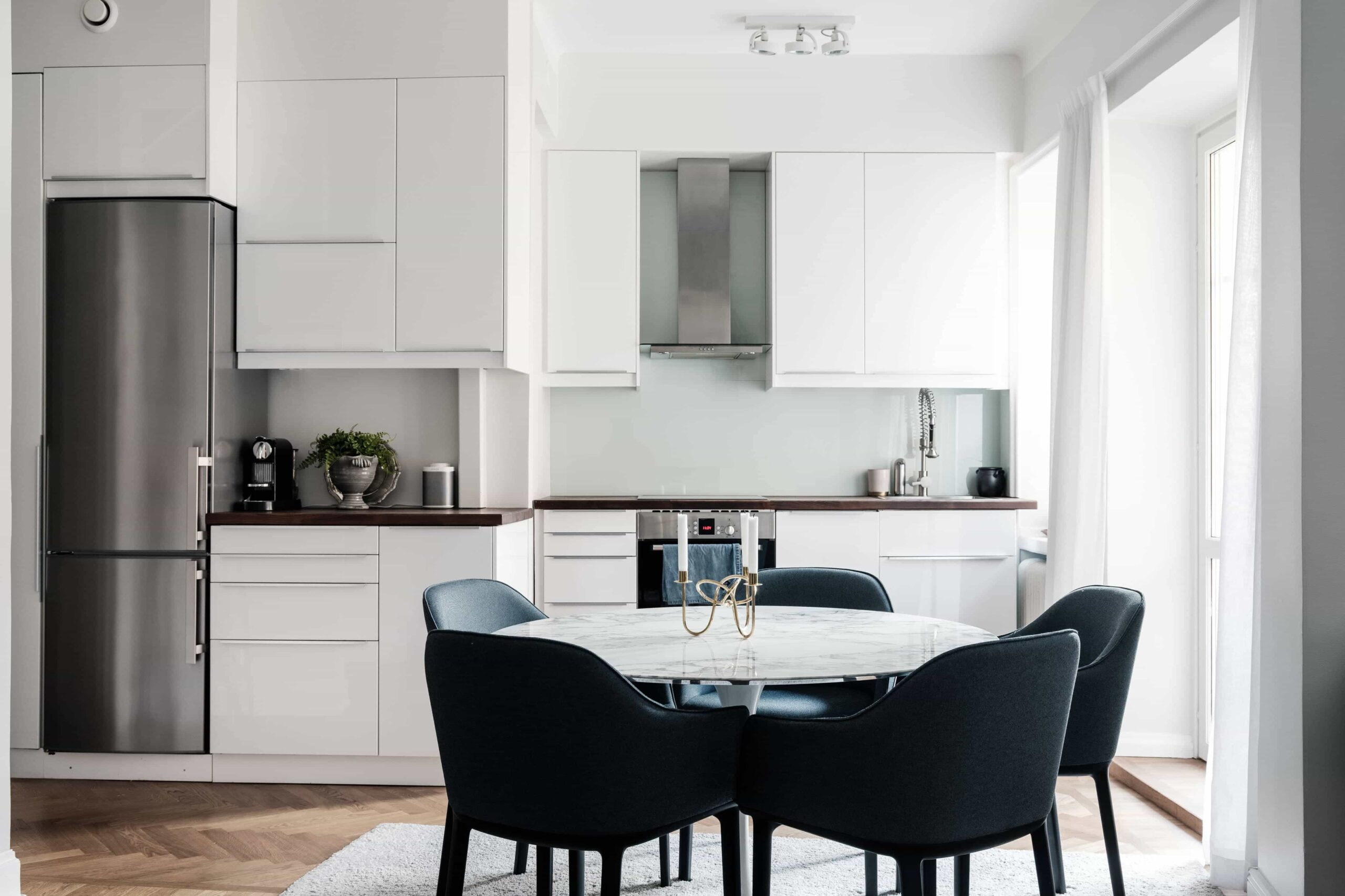 this is a scandinavian kitchen with velvet vintage chairs