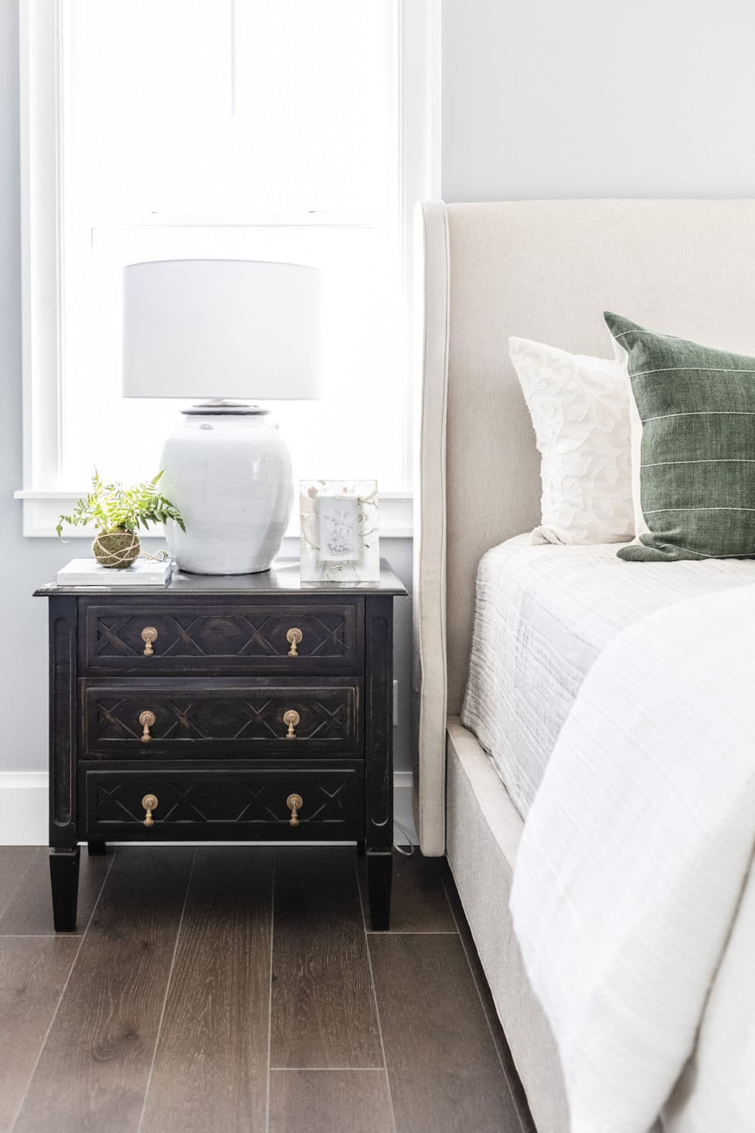 this is a shabby chic bedroom with light blue walls