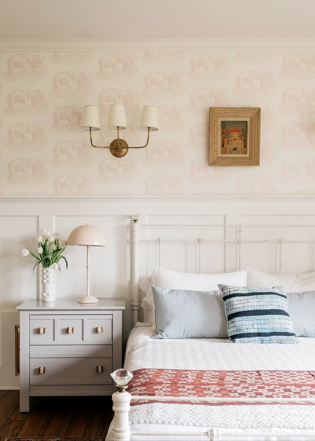 this is a shabby chic bedroom with light pink elephant wallpaper