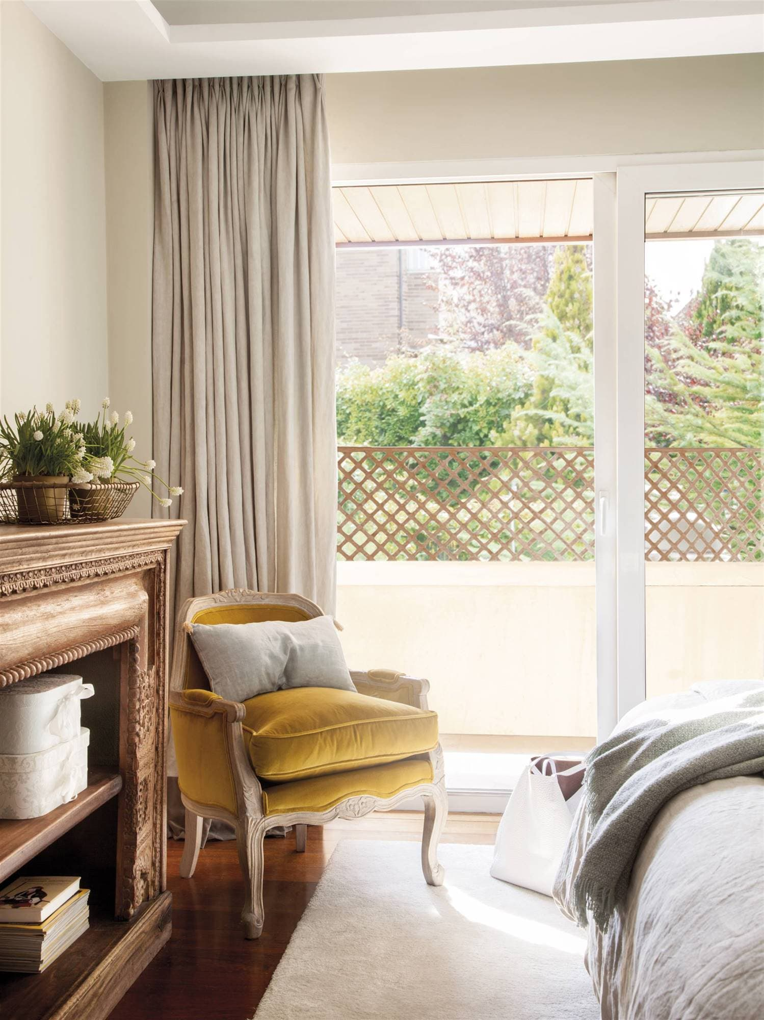 this is a shabby chic bedroom with light yellow walls