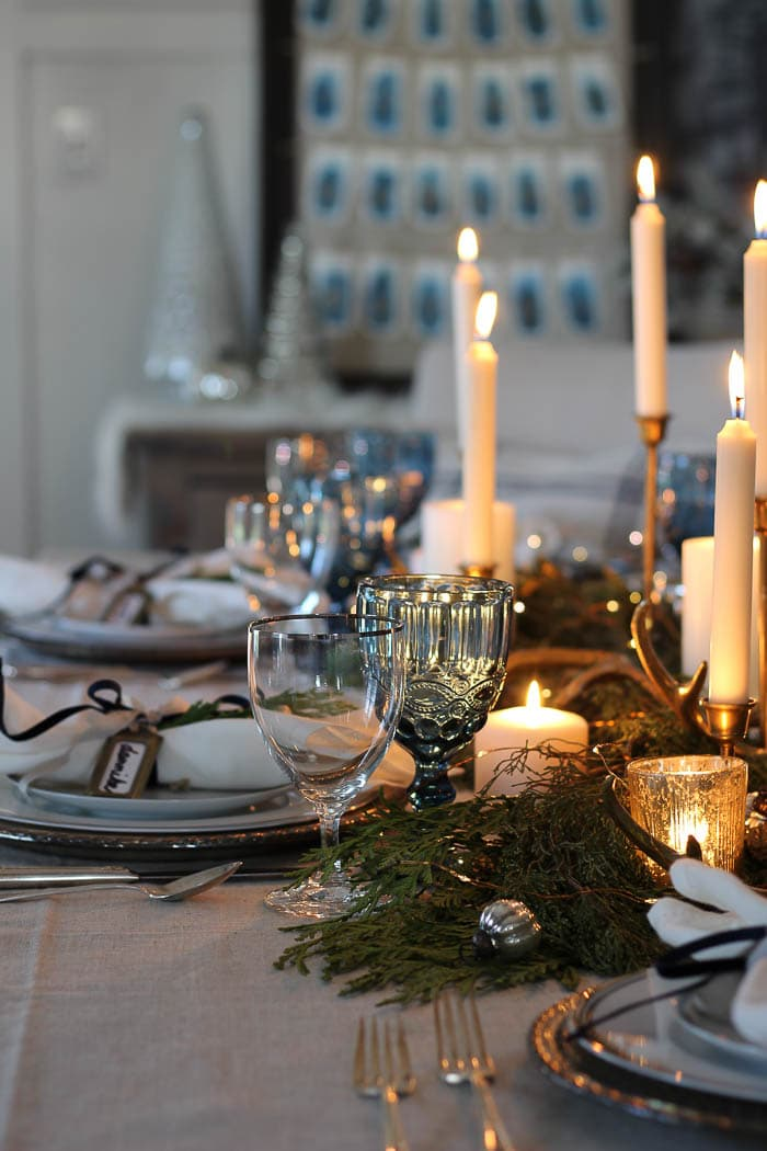 this is a beige and blue tablescape with pretty glassware