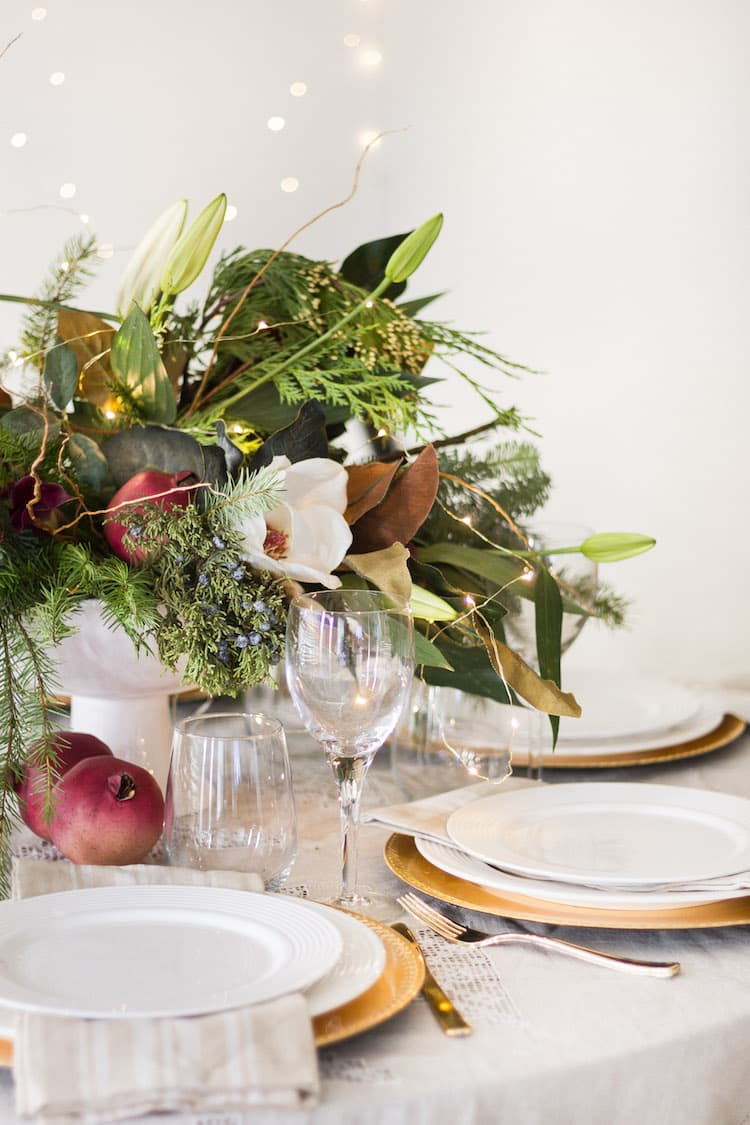 this is a christmas tablescape with a large floral centrepeice