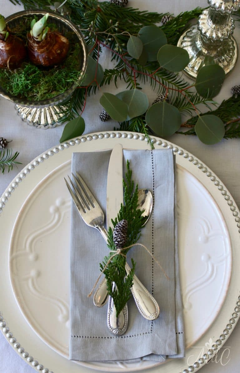 this is a christmas tablescape with blue and silver elements
