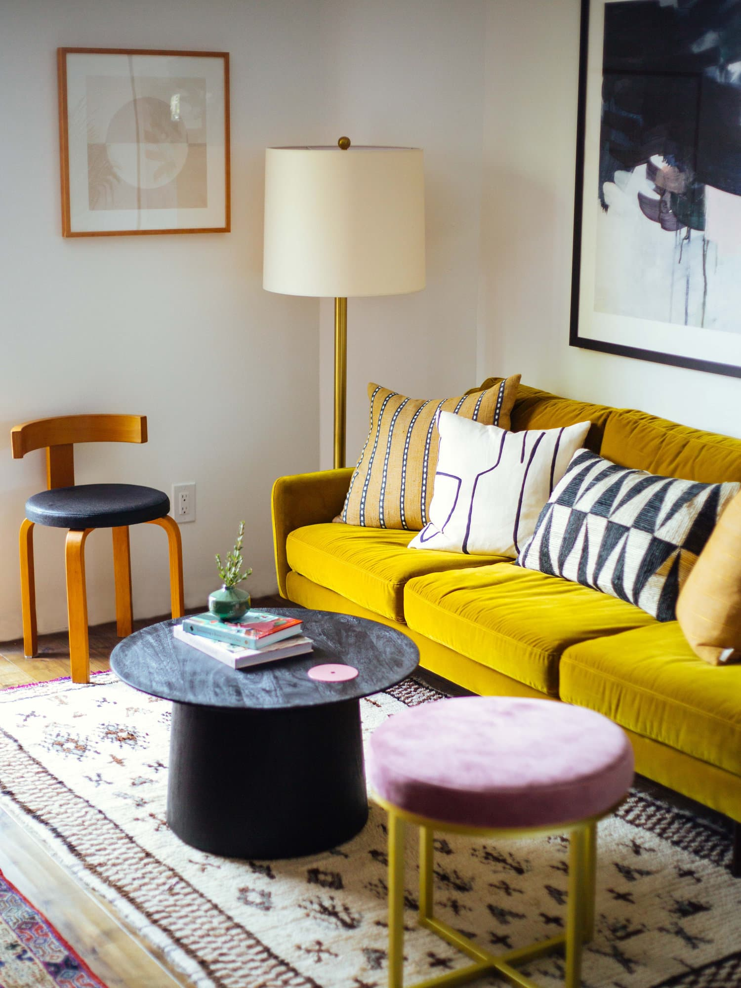 this is a eclectic mid century modern inspired living room with vintage pieces
