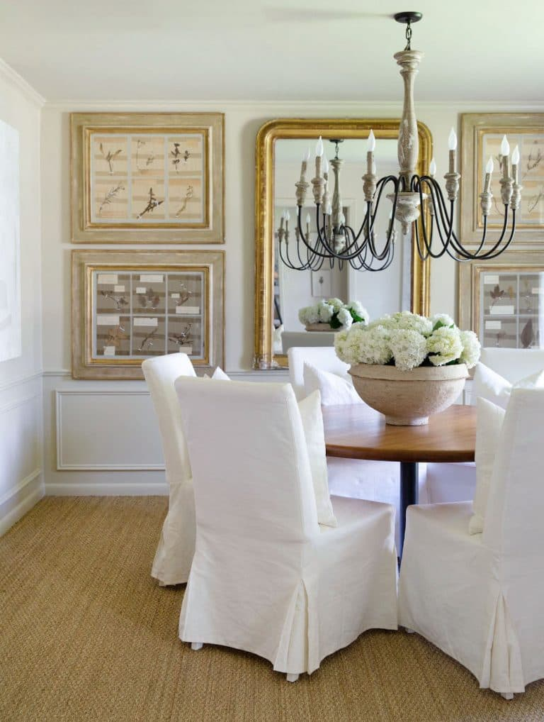 this is a french country dining room with shabby chic inspired slip covers and golden accents