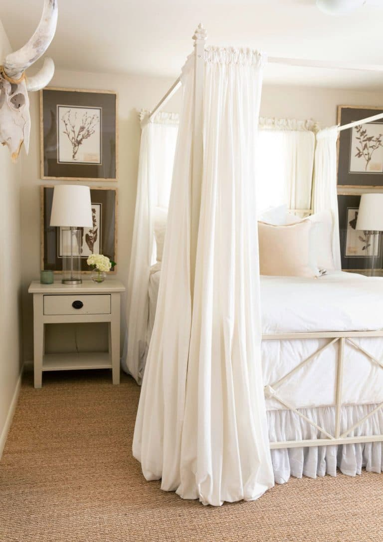 this is a french country inspired bedroom with draping curtains