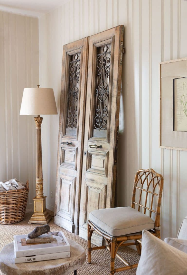 this is a french country inspired living room with wooden accents