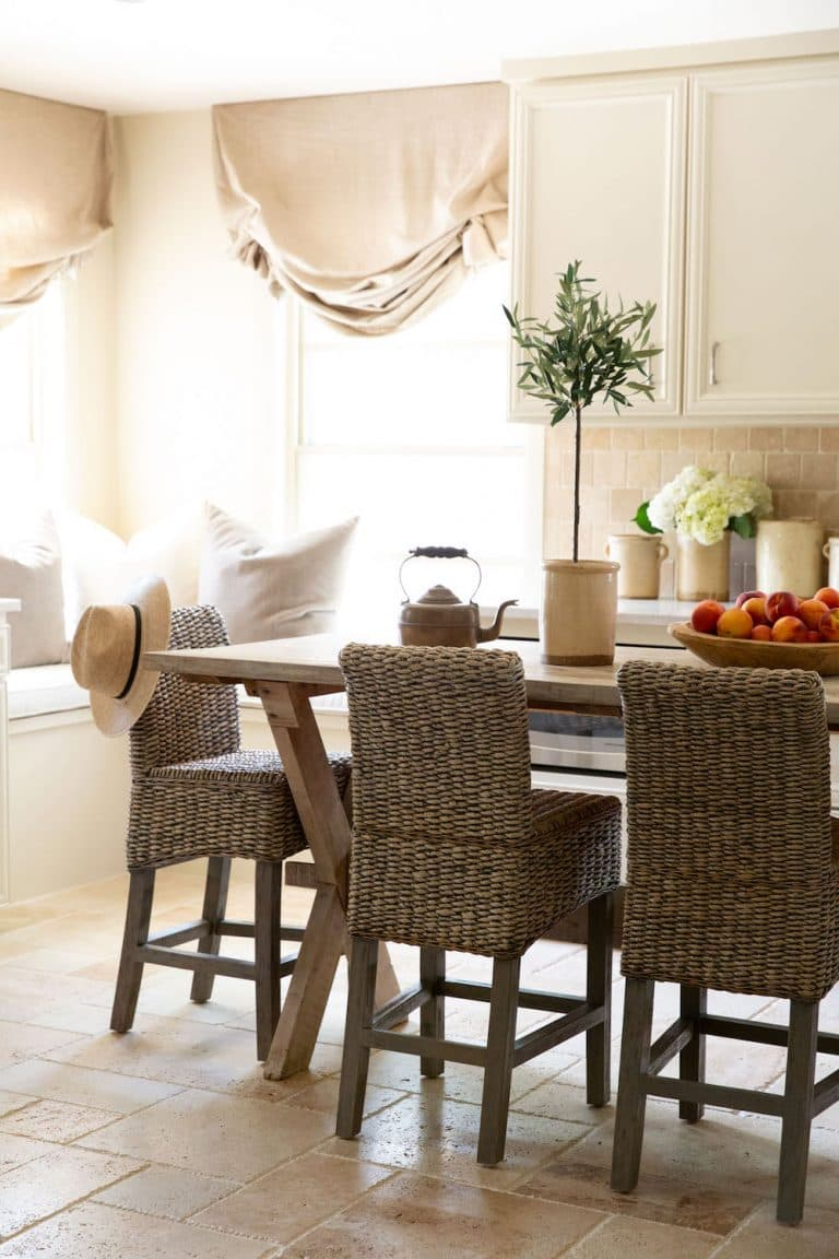 this is a kitchen with rattan dining chairs