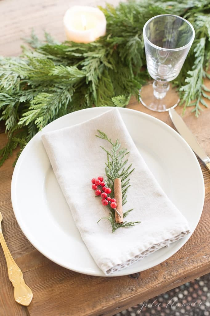 this is a simple and minimal tablescape with winterberries